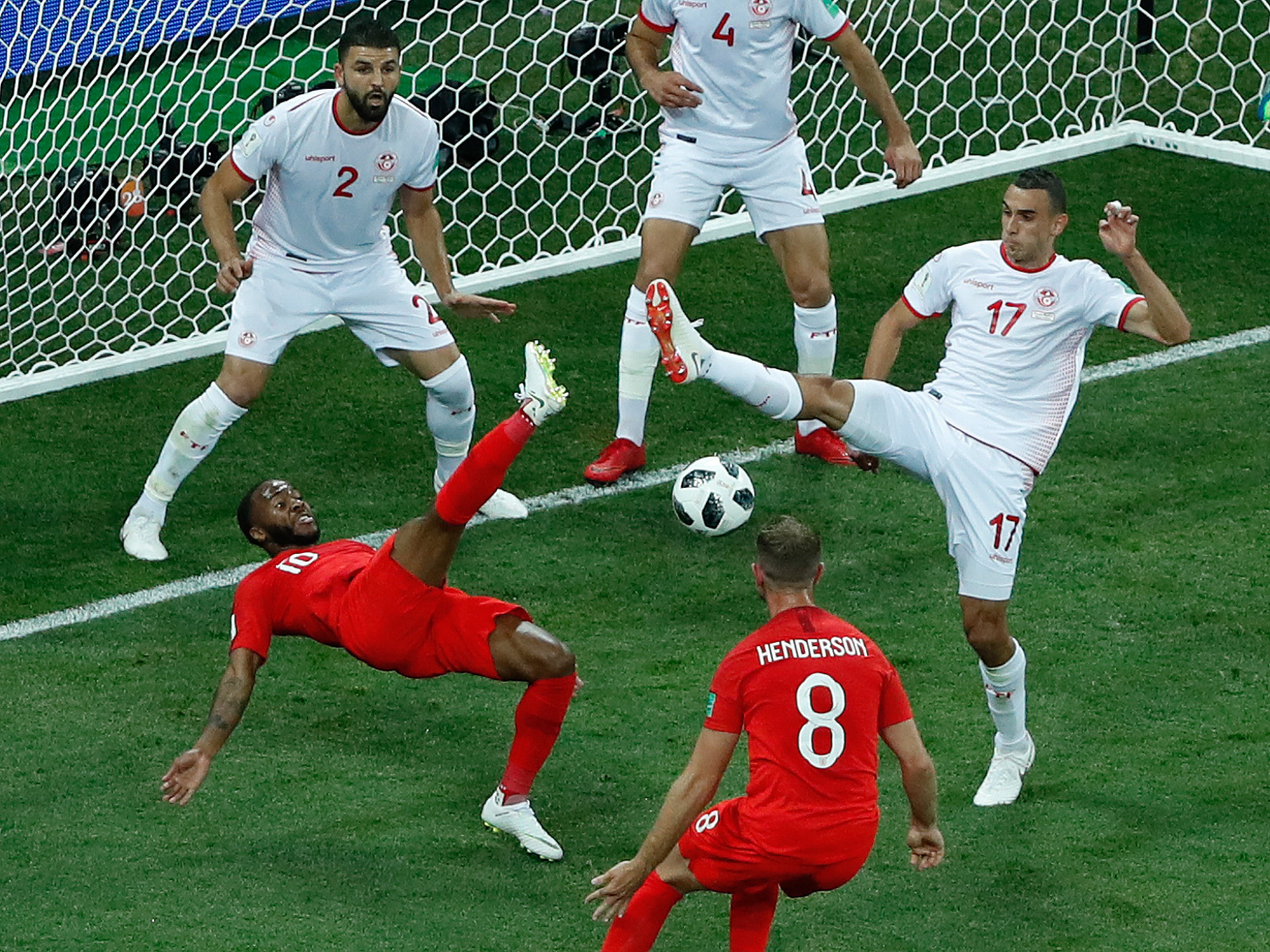 "<div class=""meta image-caption""><div class=""origin-logo origin-image none""><span>none</span></div><span class=""caption-text"">Tunisia's Ellyes Skhiri, right, and England's Raheem Sterling fight for the ball during the group G match between Tunisia and England (Rebecca Blackwell/AP Photo)</span></div>"