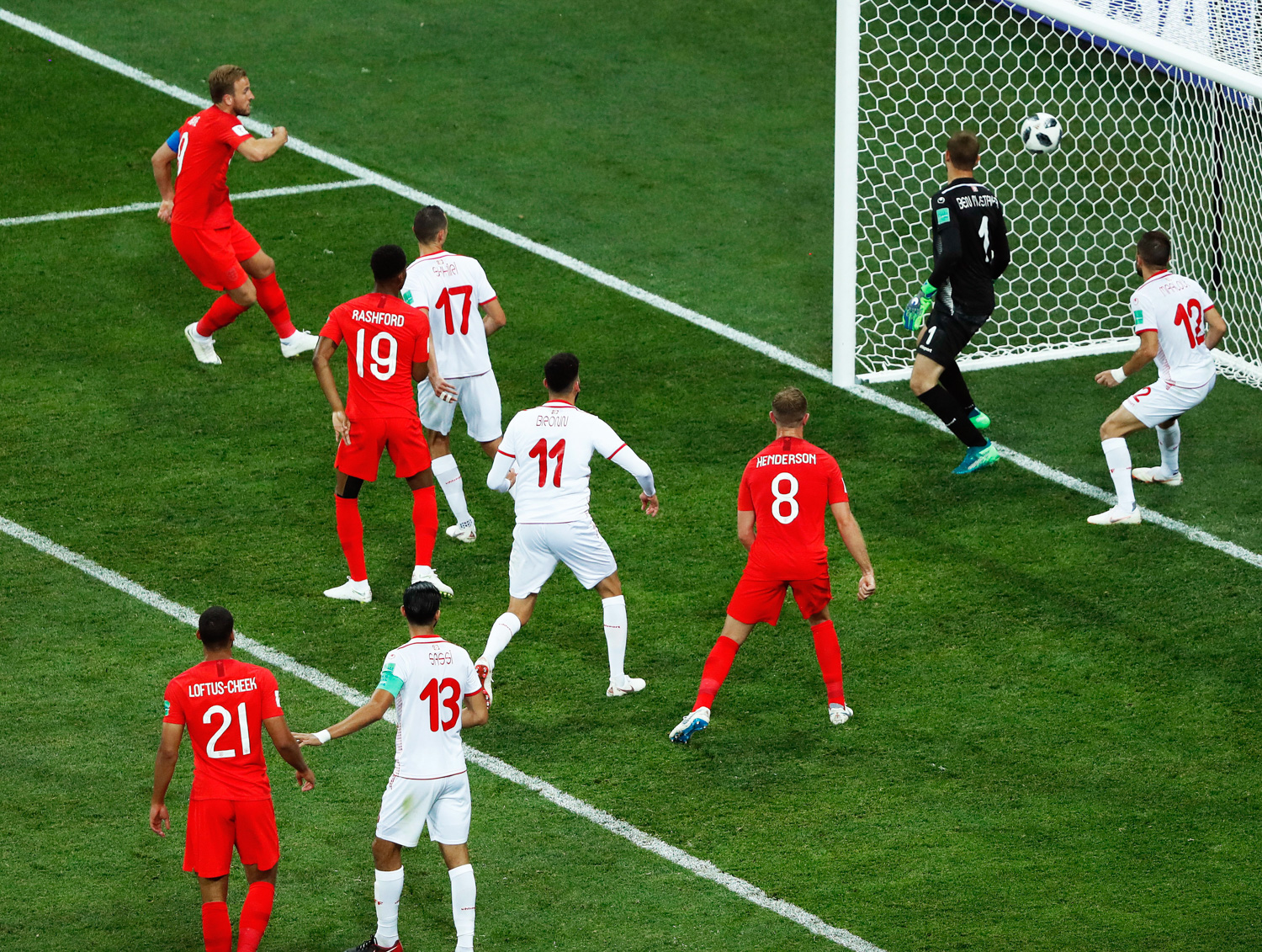 <div class='meta'><div class='origin-logo' data-origin='none'></div><span class='caption-text' data-credit='Rebecca Blackwell/AP Photo'>England's Harry Kane, left, scores his side's winning goal during the group G match between Tunisia and England</span></div>