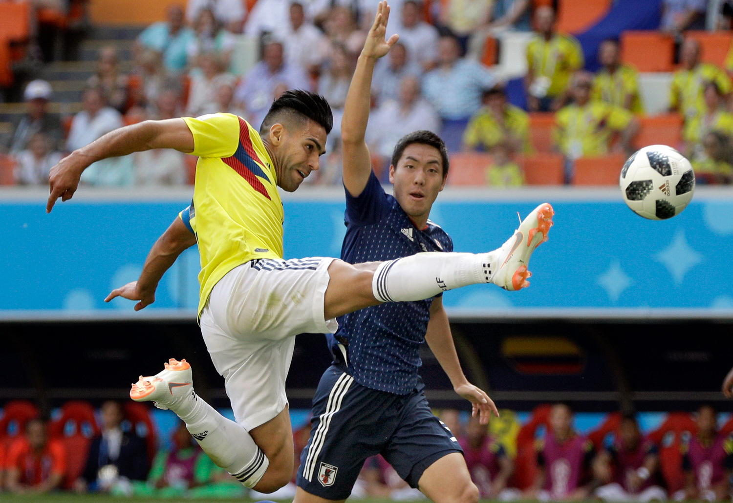 <div class='meta'><div class='origin-logo' data-origin='none'></div><span class='caption-text' data-credit='Mark Baker/AP Photo'>Colombia's Radamel Falcao, left, plays the ball during the group H match between Colombia and Japan at the 2018 soccer World Cup</span></div>
