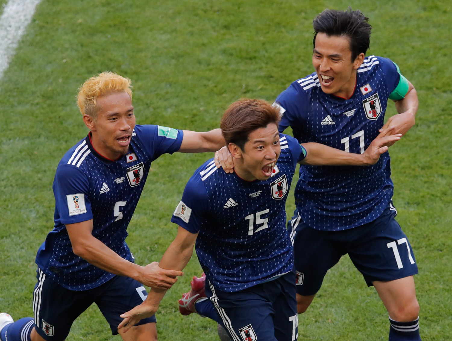 "<div class=""meta image-caption""><div class=""origin-logo origin-image none""><span>none</span></div><span class=""caption-text"">Japan's Yuya Osako celebrates after scoring his side's 2nd goal with teammates Makoto Hasebe, right, and Yuto Nagatomo, left, during the group H match between Colombia and Japan (Vadim Ghirda/AP Photo)</span></div>"