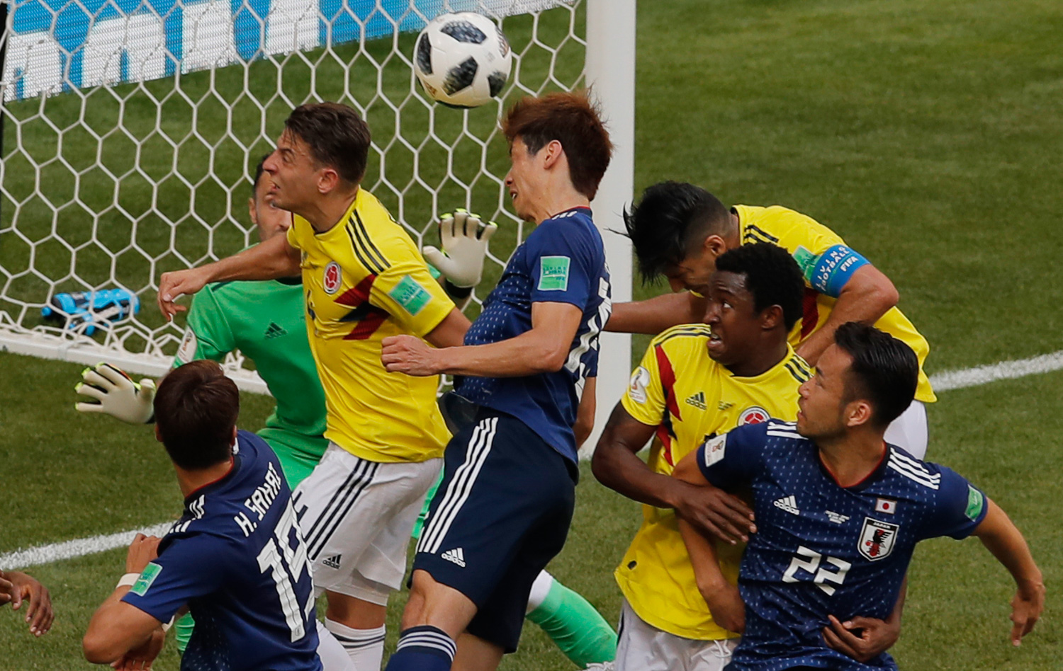 <div class='meta'><div class='origin-logo' data-origin='none'></div><span class='caption-text' data-credit='Vadim Ghirda/AP Photo'>Japan's Yuya Osako, center, scores his side second goal during the group H match between Colombia and Japan</span></div>