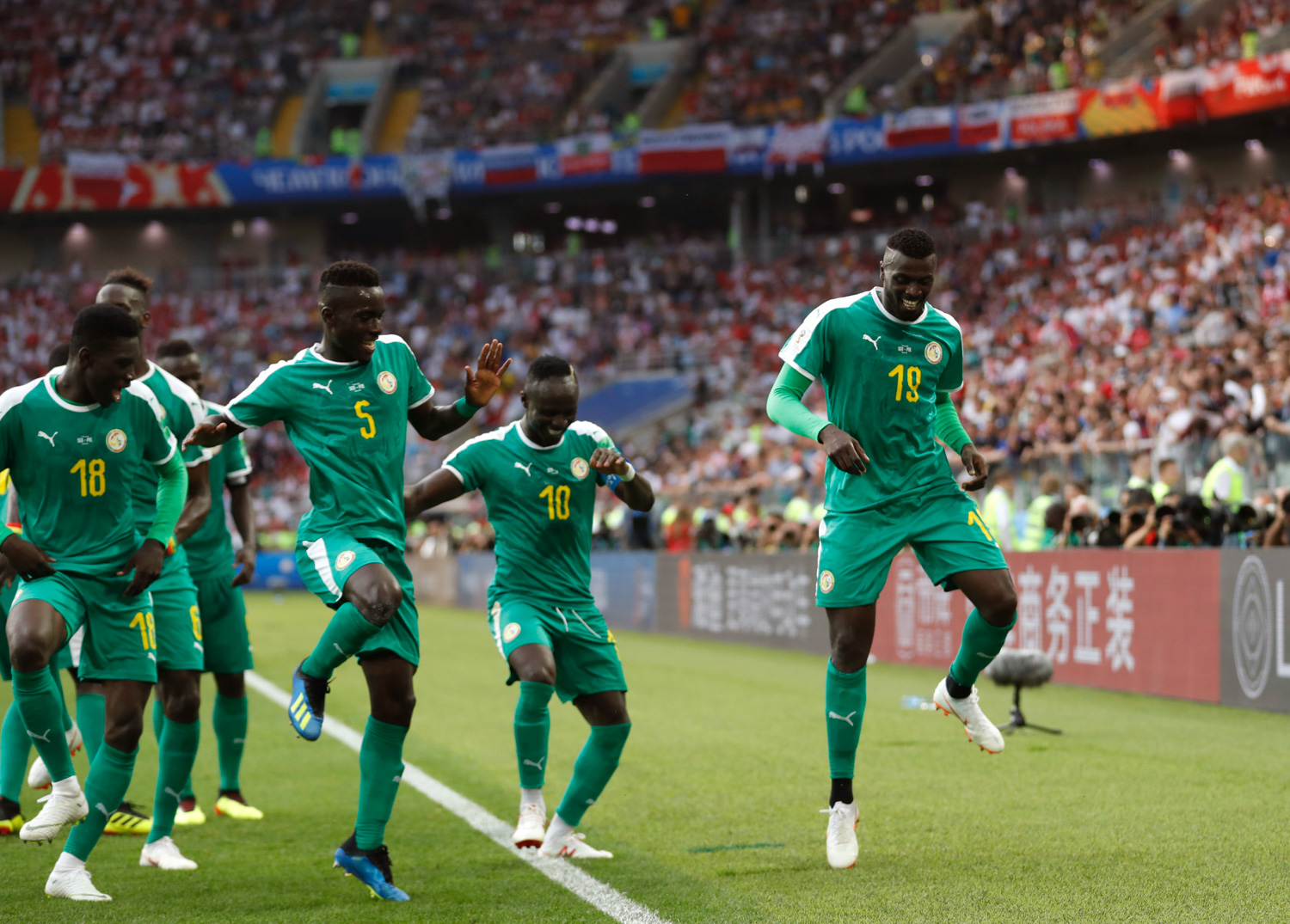 <div class='meta'><div class='origin-logo' data-origin='none'></div><span class='caption-text' data-credit='Eduardo Verdugo/AP'>Senegal's Mbaye Niang, right, dances in celebration with his teammates scoring his side's second goalduring the group H match between Poland and Senegal</span></div>