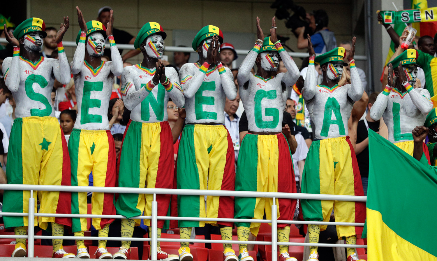 "<div class=""meta image-caption""><div class=""origin-logo origin-image none""><span>none</span></div><span class=""caption-text"">Senegal's fans, their bodies and faces painted in the colors of the national flag, support their team during the group H match between Poland and Senegal (Andrew Medichini/AP)</span></div>"
