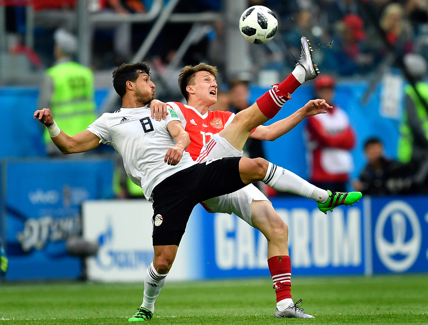 "<div class=""meta image-caption""><div class=""origin-logo origin-image none""><span>none</span></div><span class=""caption-text"">Egypt's Tarek Hamed, left, and Russia's Alexander Golovin compete for the ball during the group A match between Russia and Egypt (Martin Meissner/AP)</span></div>"