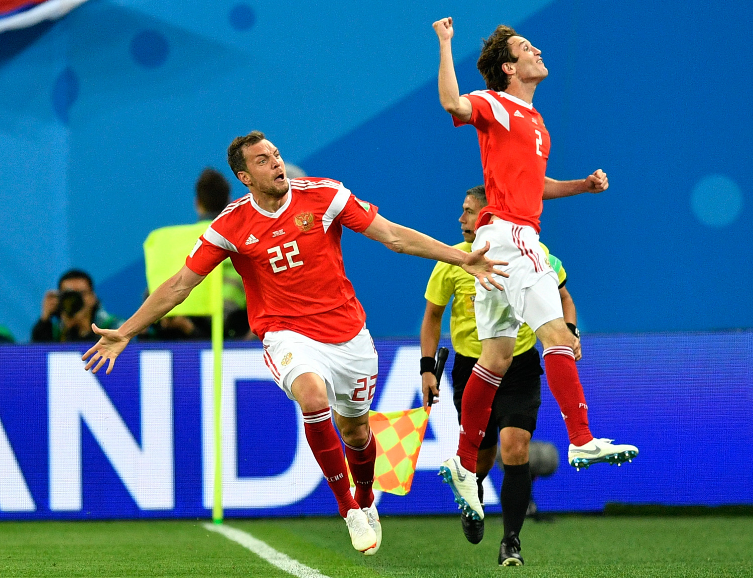 "<div class=""meta image-caption""><div class=""origin-logo origin-image none""><span>none</span></div><span class=""caption-text"">Russia's Artyom Dzyuba, left, celebrates with Russia's Mario Fernandes , right, after scoring his side's third goal during the group A match between Russia and Egypt (Martin Meissner/AP)</span></div>"