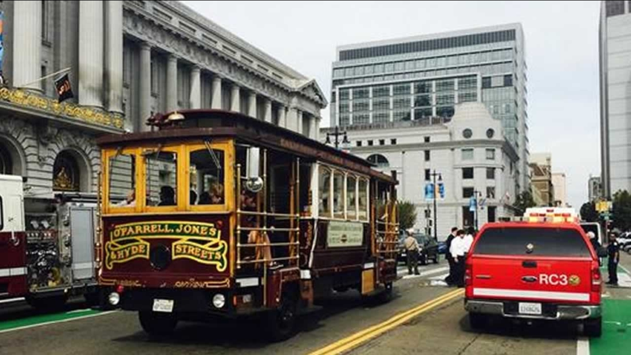 A woman was critically injured when she was hit by a tour bus near San Francisco City Hall Thursday morning.