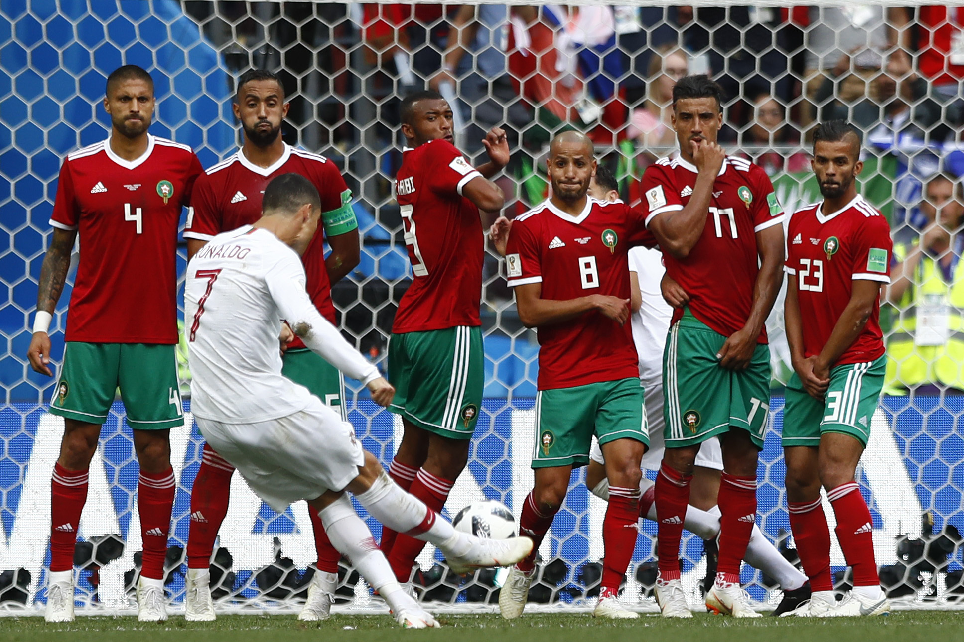<div class='meta'><div class='origin-logo' data-origin='none'></div><span class='caption-text' data-credit='Matthias Schrader/AP Photo'>Portugal's Cristiano Ronaldo takes a free kick during the group B match between Portugal and Morocco  in the Luzhniki Stadium in Moscow, Russia, Wednesday, June 20, 2018.</span></div>
