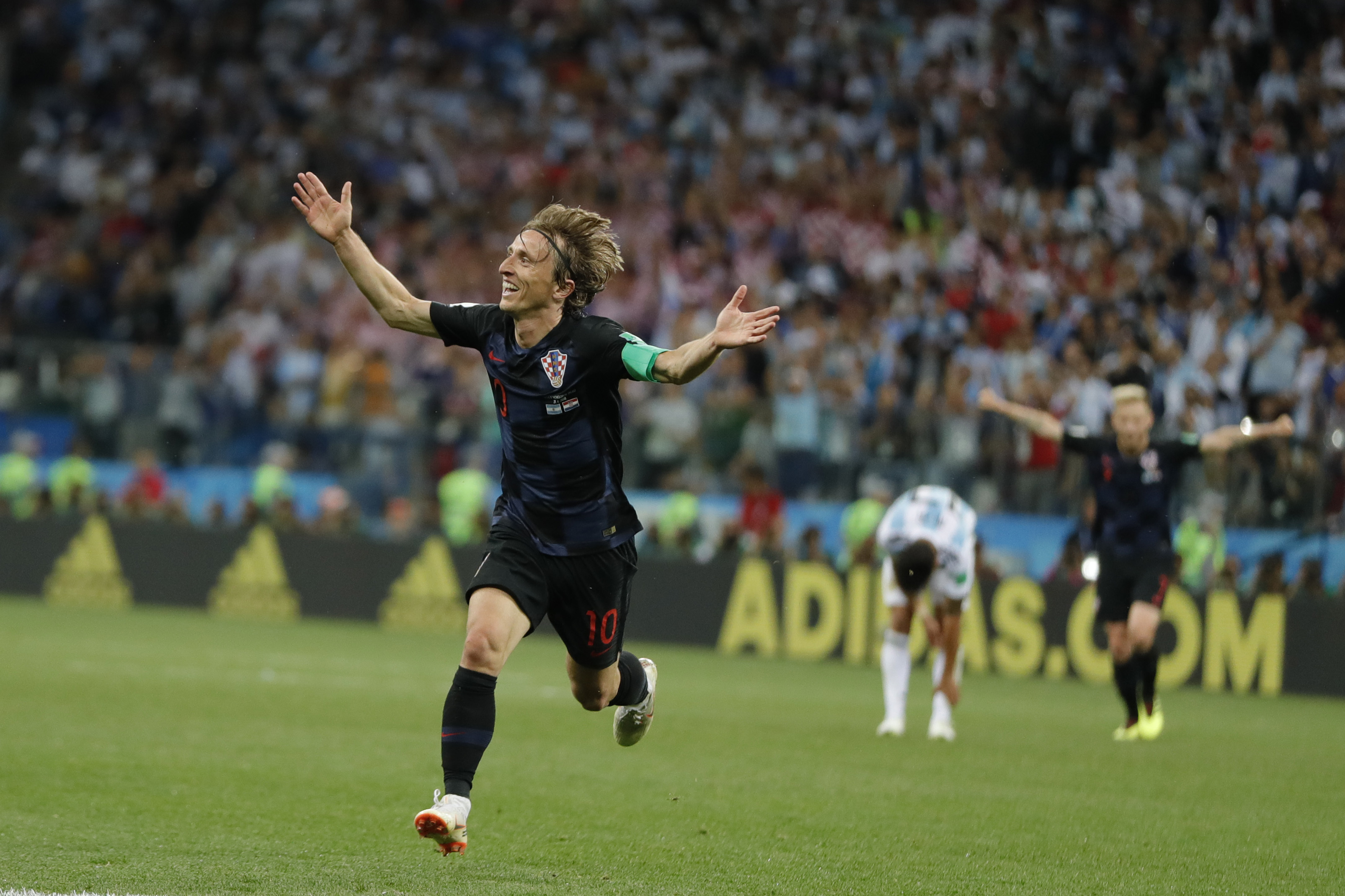 <div class='meta'><div class='origin-logo' data-origin='none'></div><span class='caption-text' data-credit='Ricardo Mazalan/AP Photo'>Croatia's Luka Modric celebrates with teammates after scoring during the group D match against Argentina on Thursday, June 21, 2018. Modric scored once in Croatia's 3-0 victory.</span></div>