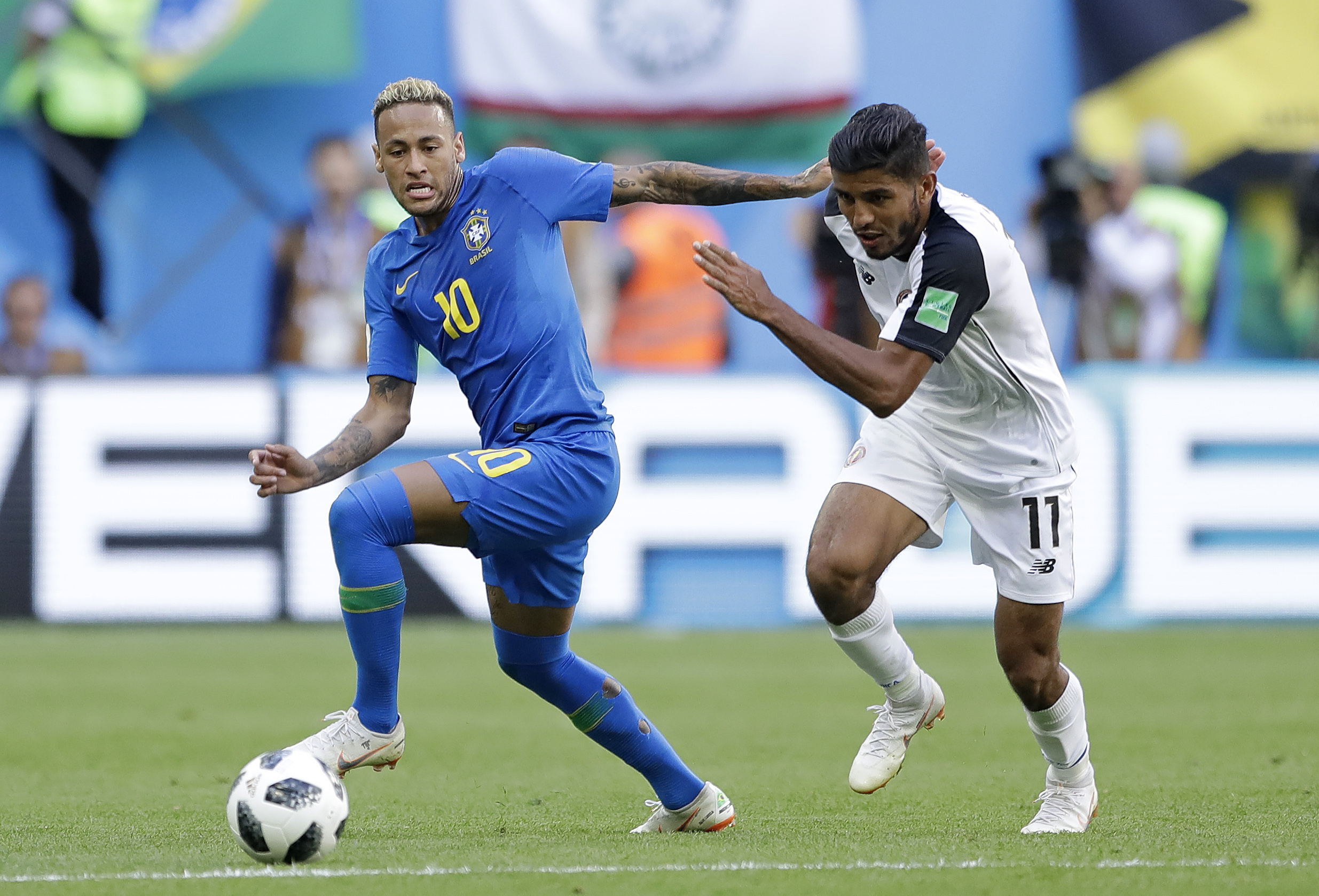 <div class='meta'><div class='origin-logo' data-origin='none'></div><span class='caption-text' data-credit='Andre Penner/AP Photo'>Brazil's Neymar and Costa Rica's Johan Venegas, right, battle for the ball during the group E match between Brazil and Costa Rica in the St. Petersburg Stadium on Friday, June 22.</span></div>