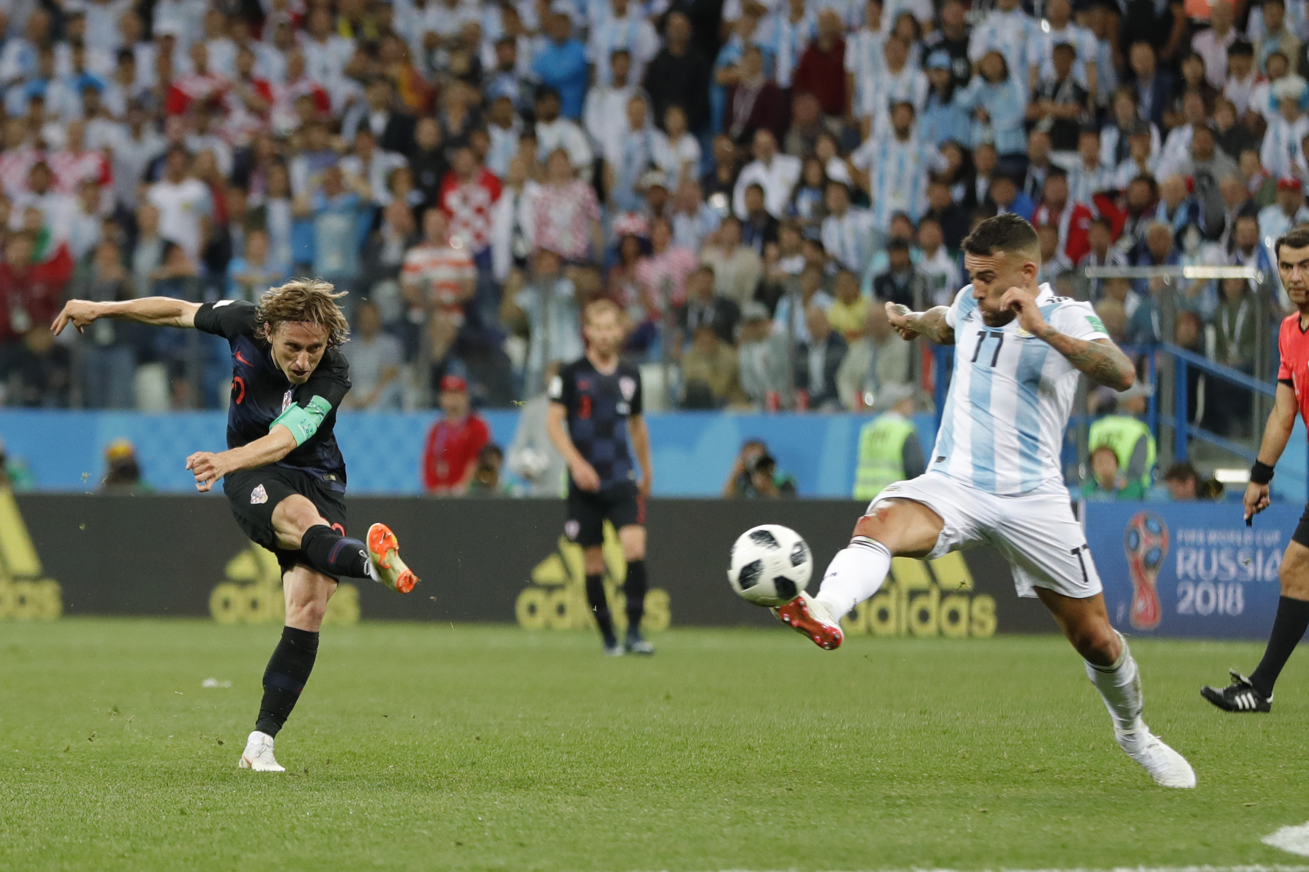 <div class='meta'><div class='origin-logo' data-origin='none'></div><span class='caption-text' data-credit='Ricardo Mazalan/AP Photo'>Croatia's Luka Modric, left, shoots the ball to score his side's second goal during the group D match between Argentina and Croatia in Nizhny Novgorod Stadium on June 21.</span></div>