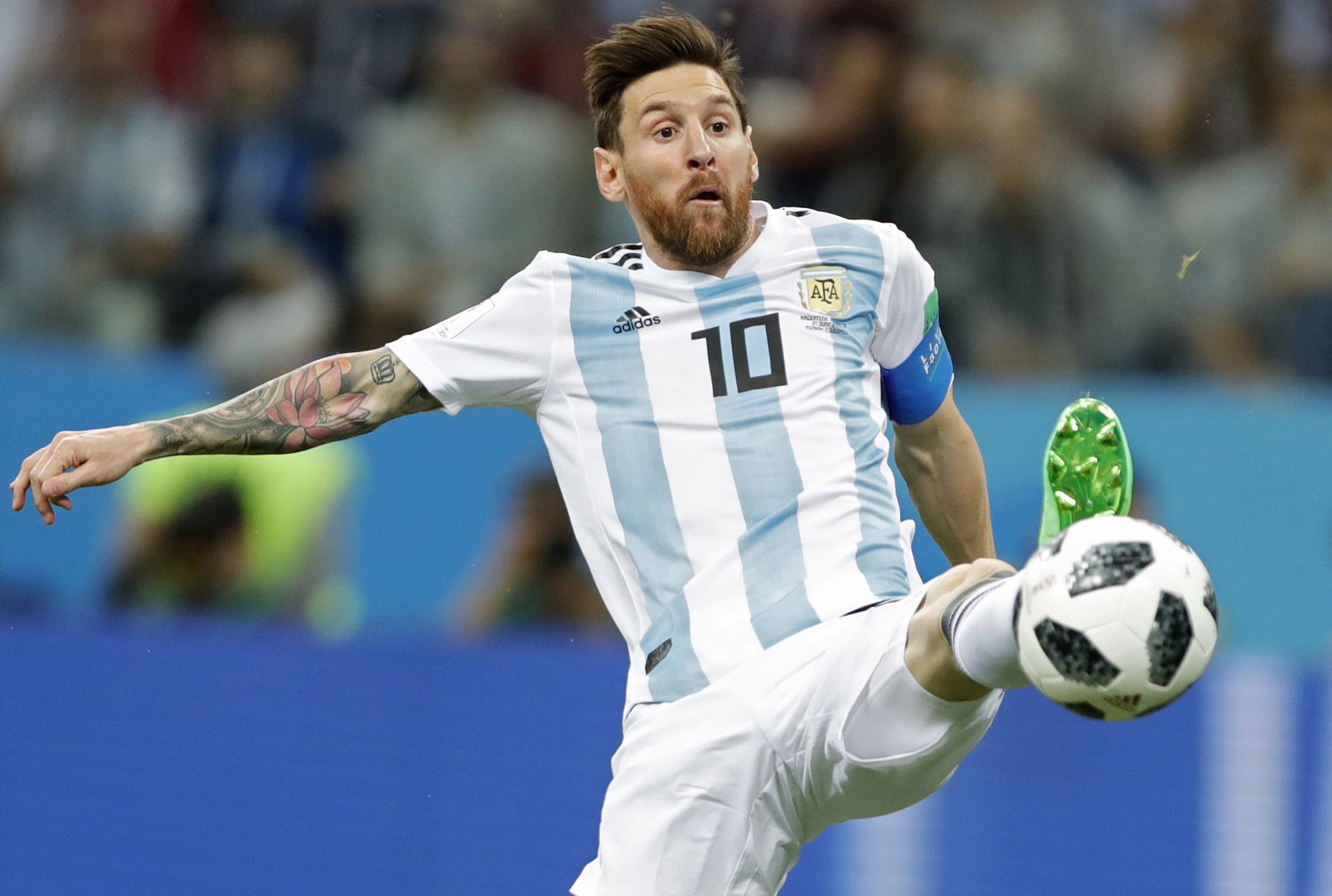 <div class='meta'><div class='origin-logo' data-origin='none'></div><span class='caption-text' data-credit='Ricardo Mazalan/AP Photo'>Argentina's Lionel Messi reaches for the ball during the group D match between Argentina and Croatia  in Nizhny Novgorod Stadium on Thursday, June 21, 2018.</span></div>