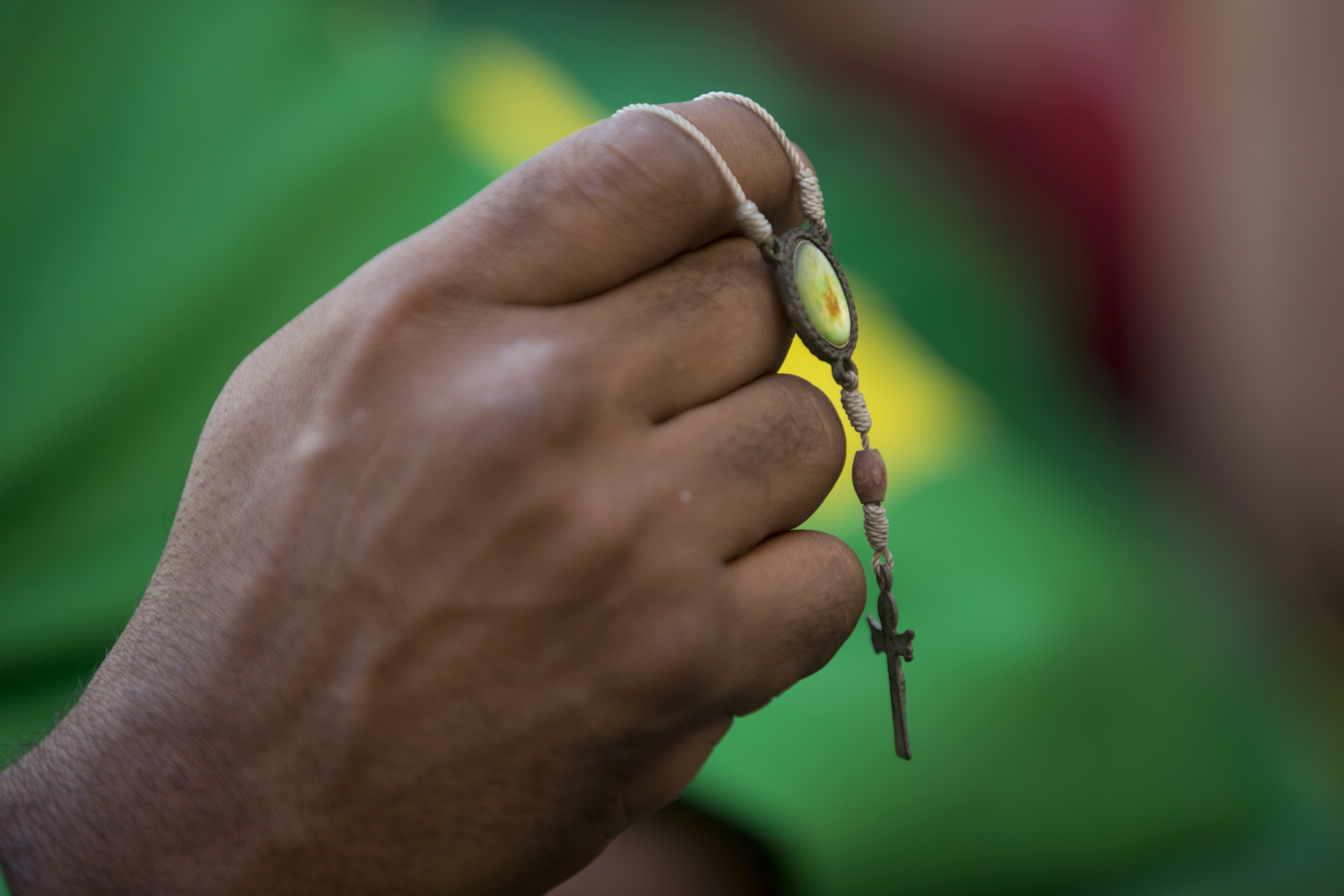 <div class='meta'><div class='origin-logo' data-origin='none'></div><span class='caption-text' data-credit='Silvia Izquierdo/AP Photo'>A Brazil soccer fan holds a cross during his team's World Cup match against Costa Rica in Rio de Janeiro, Brazil, Friday, June 22, 2018.</span></div>