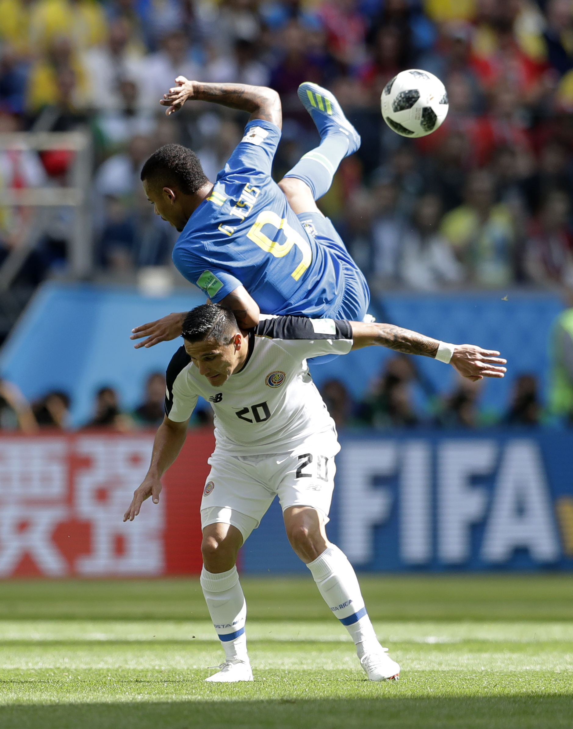 <div class='meta'><div class='origin-logo' data-origin='none'></div><span class='caption-text' data-credit='Petr David Josek/AP Photo'>Brazil's Gabriel Jesus, top, falls after jumping for a header with Costa Rica's David Guzman during the group E match between Brazil and Costa Rica on June 22.</span></div>