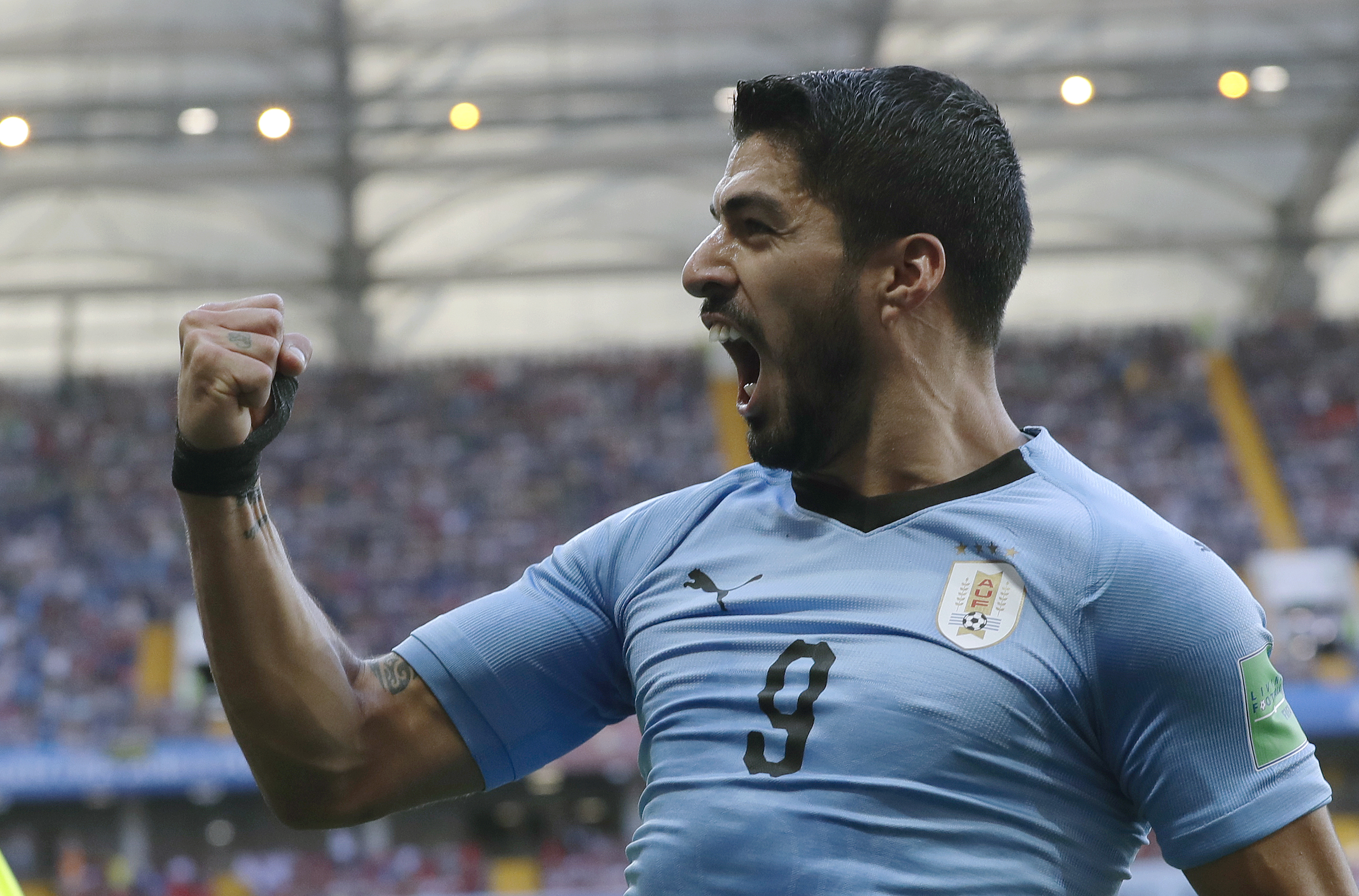 <div class='meta'><div class='origin-logo' data-origin='none'></div><span class='caption-text' data-credit='Andrew Medichini/AP Photo'>Uruguay's Luis Suarez celebrates scoring his side's first goal during the group A match against Saudi Arabia in Rostov Arena in Rostov-on-Don, Russia, June 20.</span></div>