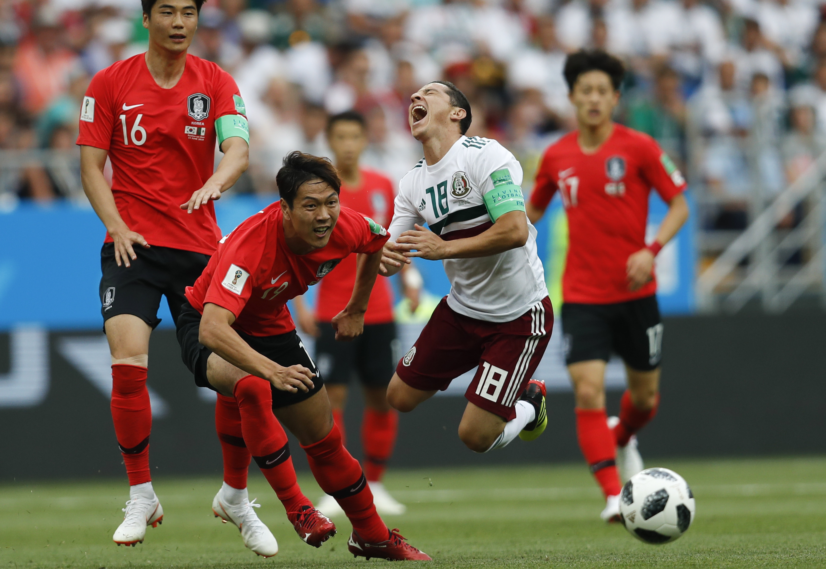 "<div class=""meta image-caption""><div class=""origin-logo origin-image none""><span>none</span></div><span class=""caption-text"">Mexico's Andres Guardado, right, challenges for the ball with South Korea's Kim Young-gwon during the group F match in the Rostov Arena on June 23. (Eduardo Verdugo/AP Photo)</span></div>"