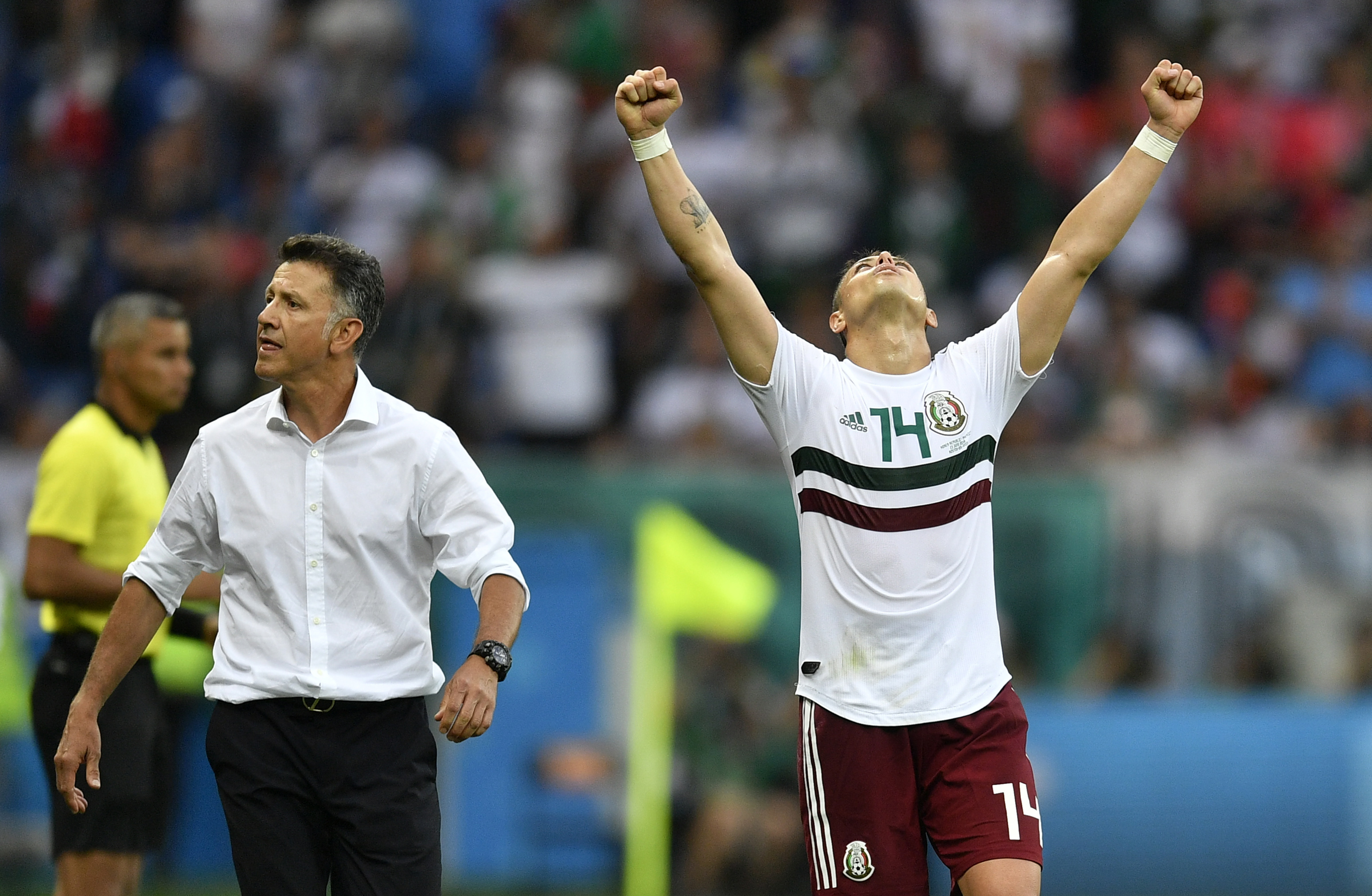"<div class=""meta image-caption""><div class=""origin-logo origin-image none""><span>none</span></div><span class=""caption-text"">Mexico's Javier Hernandez celebrates beside Mexico head coach Juan Carlos Osorio at the end of the group F match between Mexico and South Korea in the Rostov Arena on June 23. (Martin Meissner/AP Photo)</span></div>"