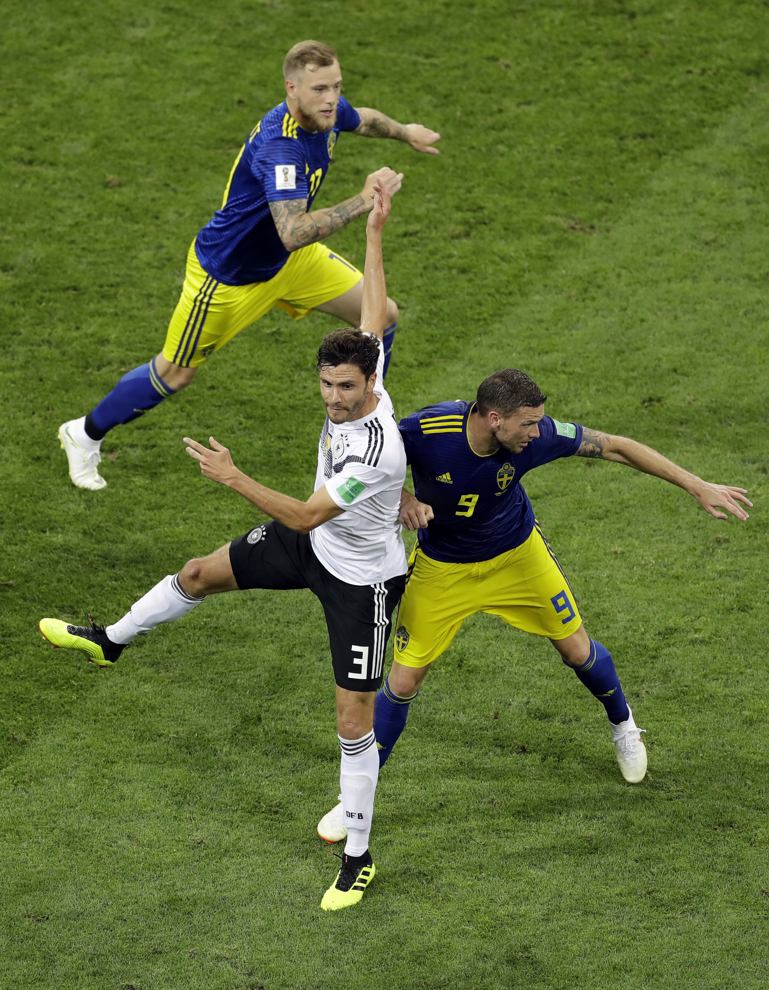 <div class='meta'><div class='origin-logo' data-origin='none'></div><span class='caption-text' data-credit='Sergei Grits/AP Photo'>Germany's Jonas Hector, left, collides with Sweden's Marcus Berg during the group F match in the Fisht Stadium in Sochi, Russia, Saturday, June 23, 2018.</span></div>