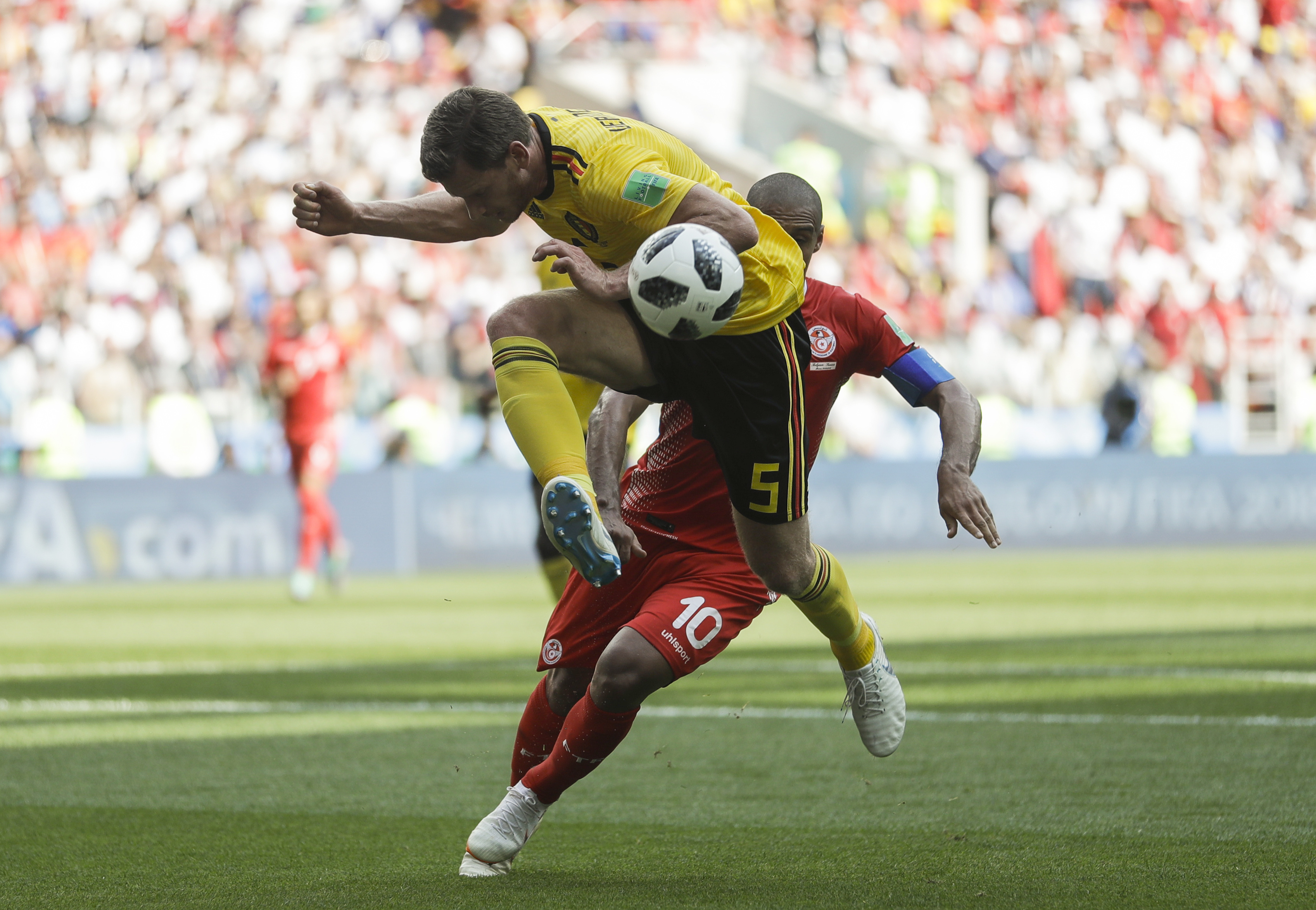 <div class='meta'><div class='origin-logo' data-origin='none'></div><span class='caption-text' data-credit='Matthias Schrader/AP Photo'>Belgium's Jan Vertonghen, top, and Tunisia's Wahbi Khazri challenge for the ball during the group G match in the Spartak Stadium in Moscow, Russia, Saturday, June 23, 2018.</span></div>