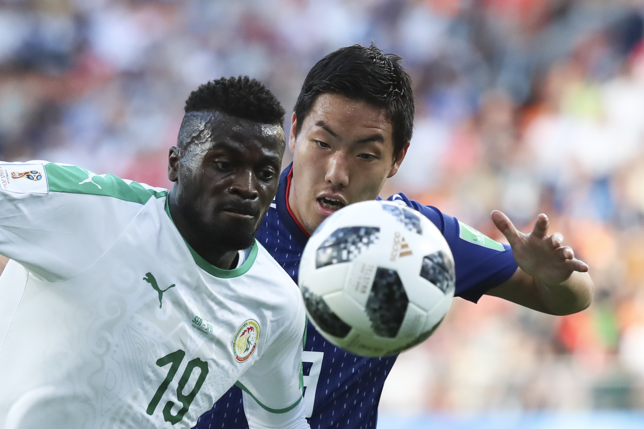 "<div class=""meta image-caption""><div class=""origin-logo origin-image none""><span>none</span></div><span class=""caption-text"">Senegal's Mbaye Niang, left, and Japan's Gen Shoji challenge for the ball during the group H match at the Yekaterinburg Arena in Yekaterinburg, Russia, Sunday, June 24, 2018. (Eugene Hoshiko/AP Photo)</span></div>"