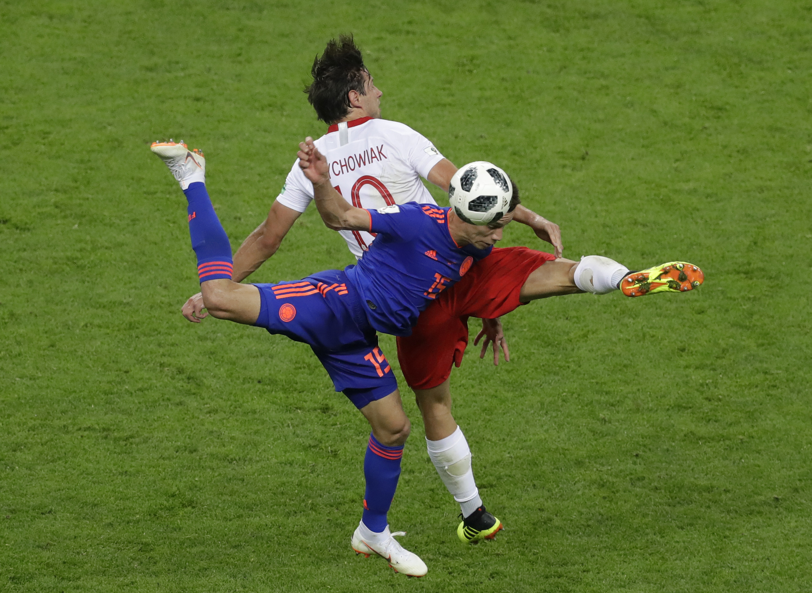 <div class='meta'><div class='origin-logo' data-origin='none'></div><span class='caption-text' data-credit='Sergei Grits/AP Photo'>Colombia's Mateus Uribe, front, and Poland's Grzegorz Krychowiak battle for the ball during the group H match at the Kazan Arena in Kazan, Russia, Sunday, June 24, 2018.</span></div>