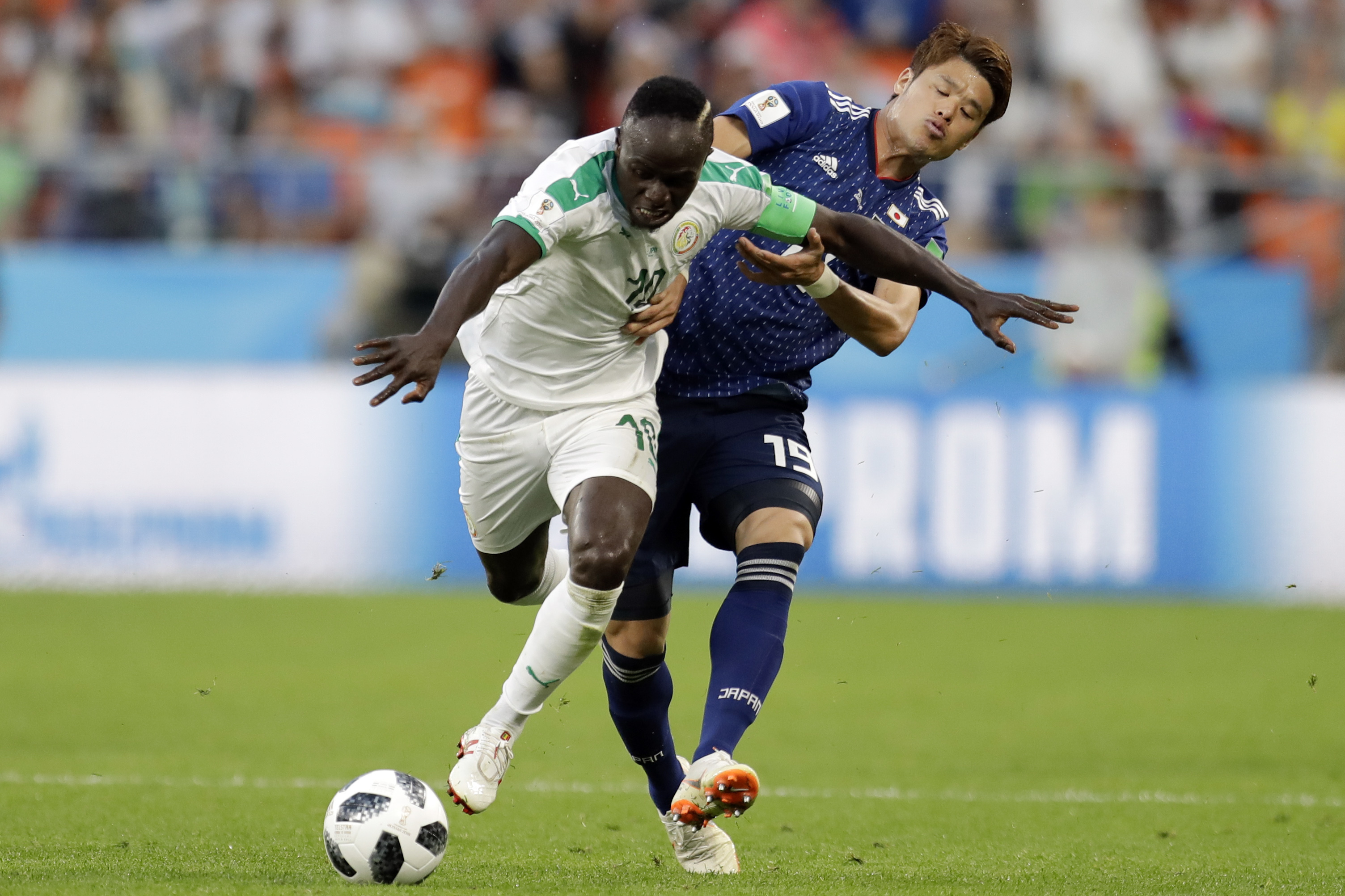 <div class='meta'><div class='origin-logo' data-origin='none'></div><span class='caption-text' data-credit='Natacha Pisarenko/AP Photo'>Senegal's Ismaila Sarr, left, and Japan's Hiroki Sakai fight for the ball during the group H match in the Yekaterinburg Arena in Yekaterinburg, Russia, Sunday, June 24, 2018.</span></div>