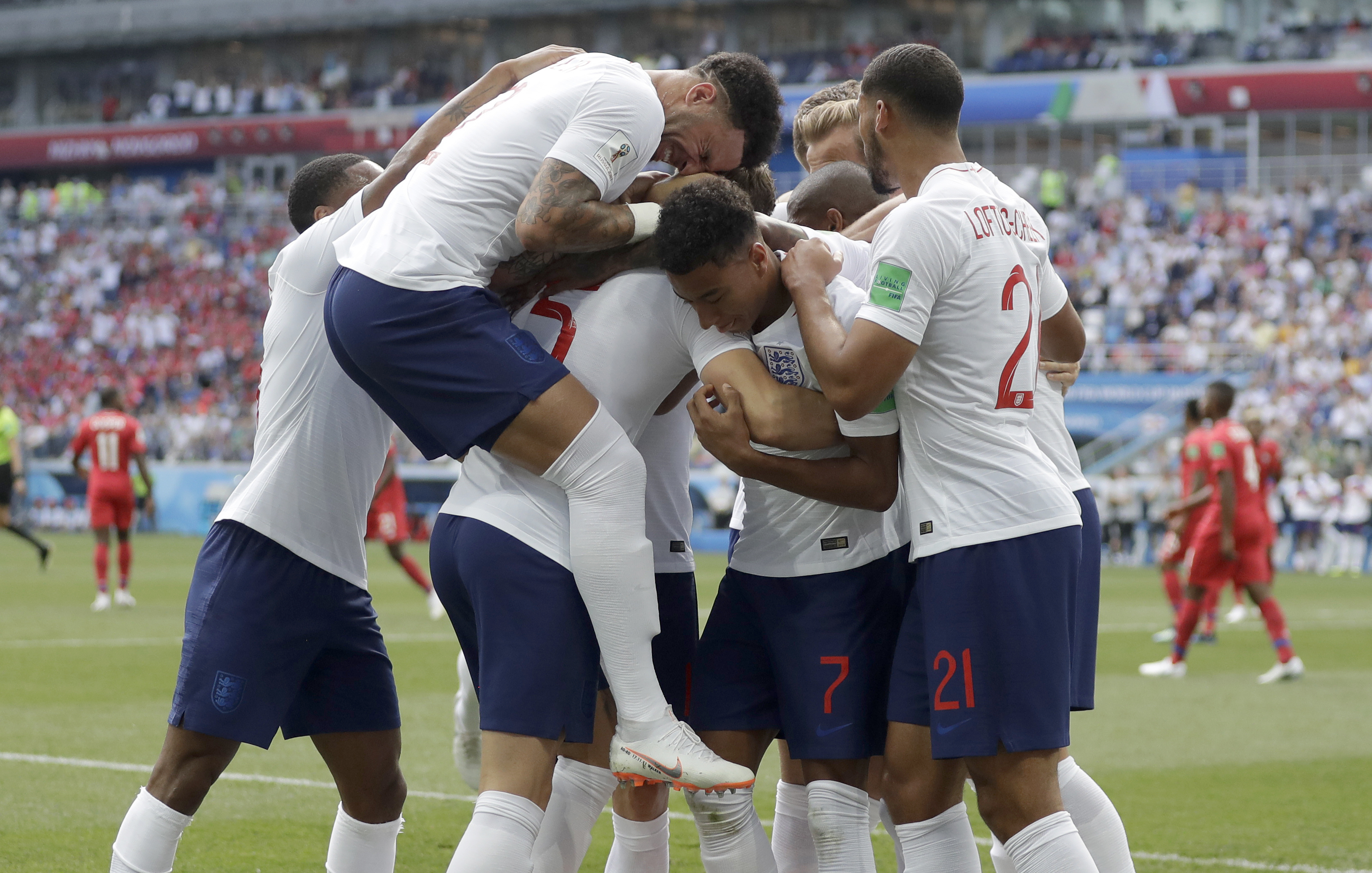 <div class='meta'><div class='origin-logo' data-origin='none'></div><span class='caption-text' data-credit='Matthias Schrader/AP Photo'>England players run to teammate John Stones after he scored his team's first goal during the group G match against Panama at the Nizhny Novgorod Stadium on Sunday, June 24, 2018.</span></div>