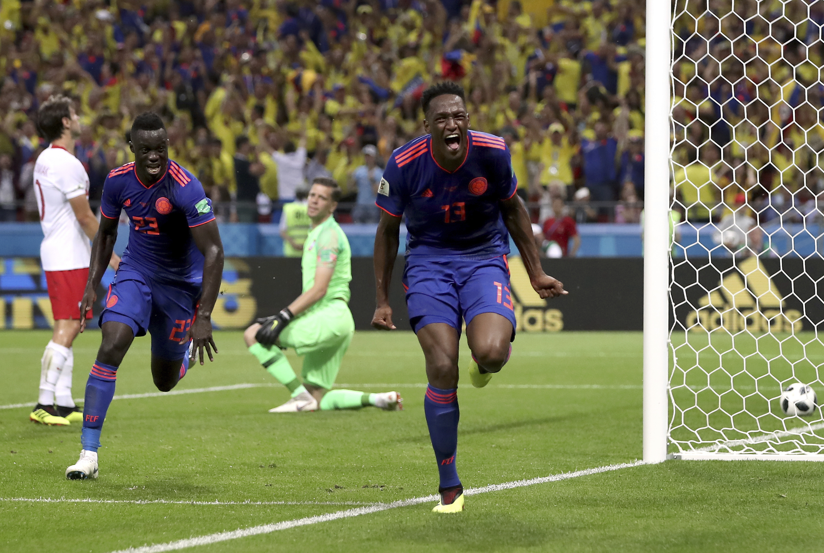 "<div class=""meta image-caption""><div class=""origin-logo origin-image none""><span>none</span></div><span class=""caption-text"">Colombia's scorer Yerry Mina, right and his teammate Davinson Sanchez, left, celebrate the opening goal during the group H match against Poland at the Kazan Arena on June 24. (Thanassis Stavrakis/AP Photo)</span></div>"