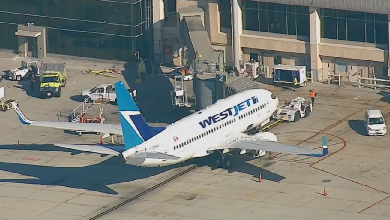 A chartered WestJet plane carrying a 2-year-old with meningitis on board was quarantined at John Wayne Airport in Orange County on Friday afternoon, Oct. 24, 2014.