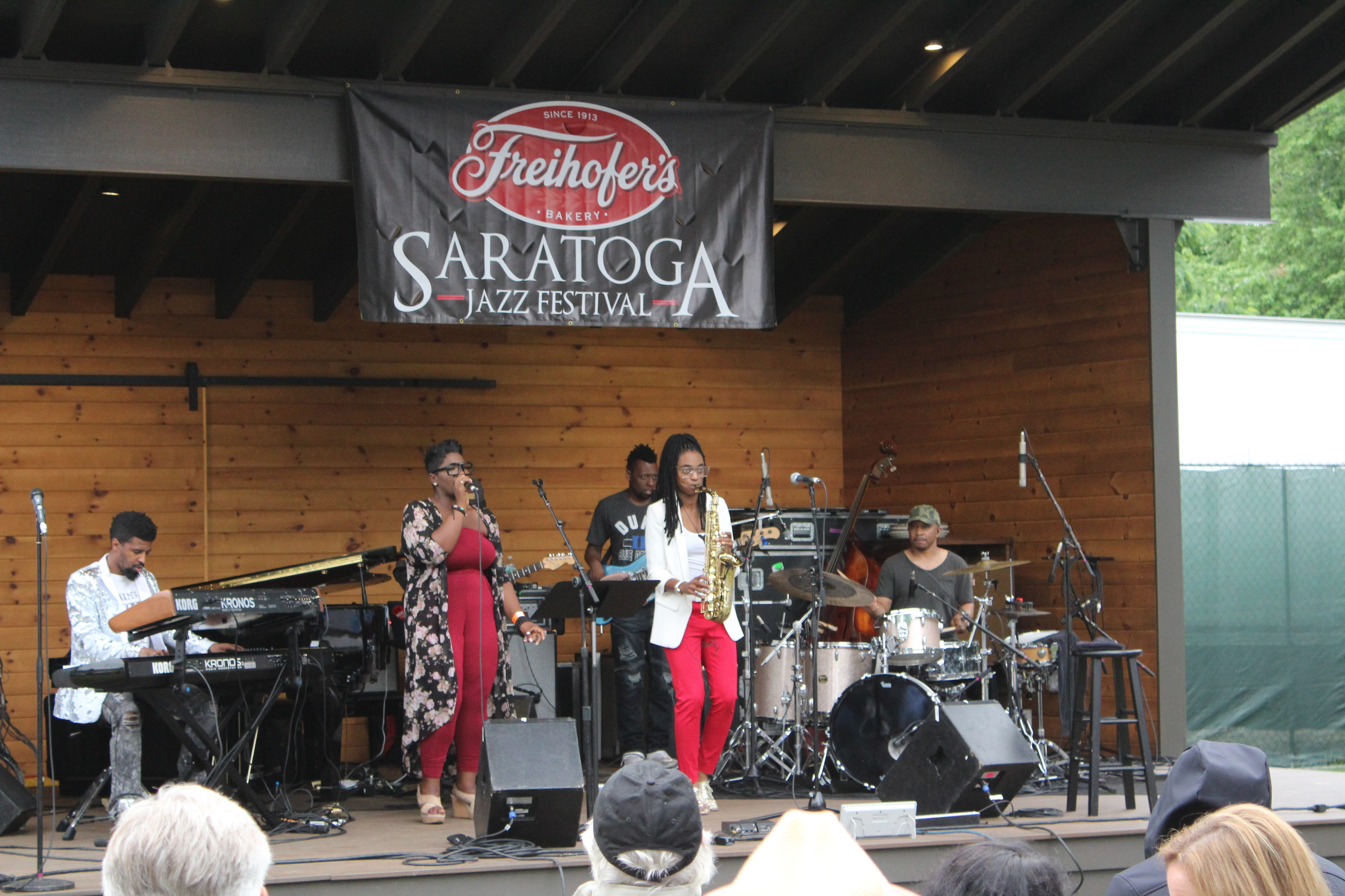 "<div class=""meta image-caption""><div class=""origin-logo origin-image wabc""><span>WABC</span></div><span class=""caption-text"">Lakecia Benjamin and SoulSquad perform on the Charles R. Wood Stage in between raindrops on Saturday. (Calvin B. De Mond)</span></div>"