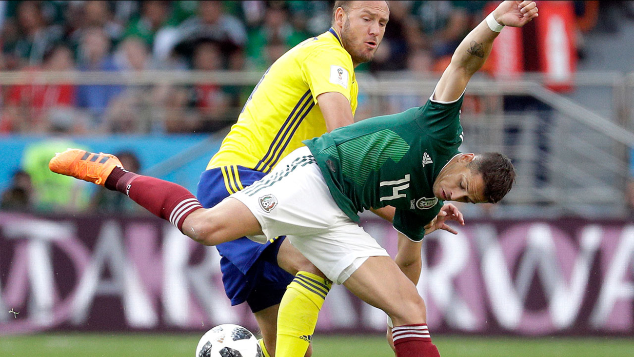 Sweden's Andreas Granqvist and Mexico's Javier Hernandez challenge for the ball at the 2018 soccer World Cup in Russia, Wednesday, June 27, 2018.