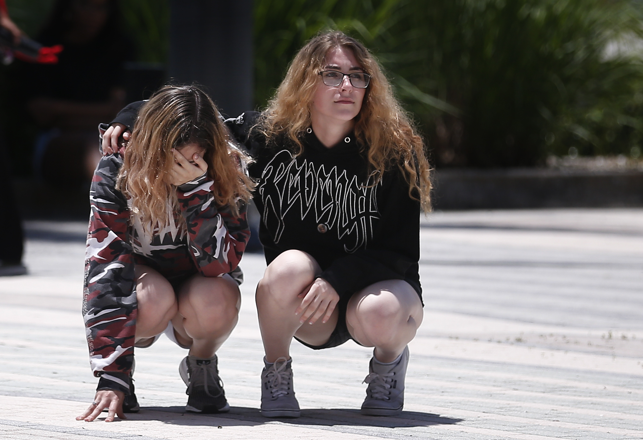 <div class='meta'><div class='origin-logo' data-origin='AP'></div><span class='caption-text' data-credit='AP'>A fan cries, left, as a friend consoles her after a memorial service for rapper, XXXTentacion, Wednesday, June 27, 2018, in Sunrise, Fla. (AP Photo/Brynn Anderson)</span></div>