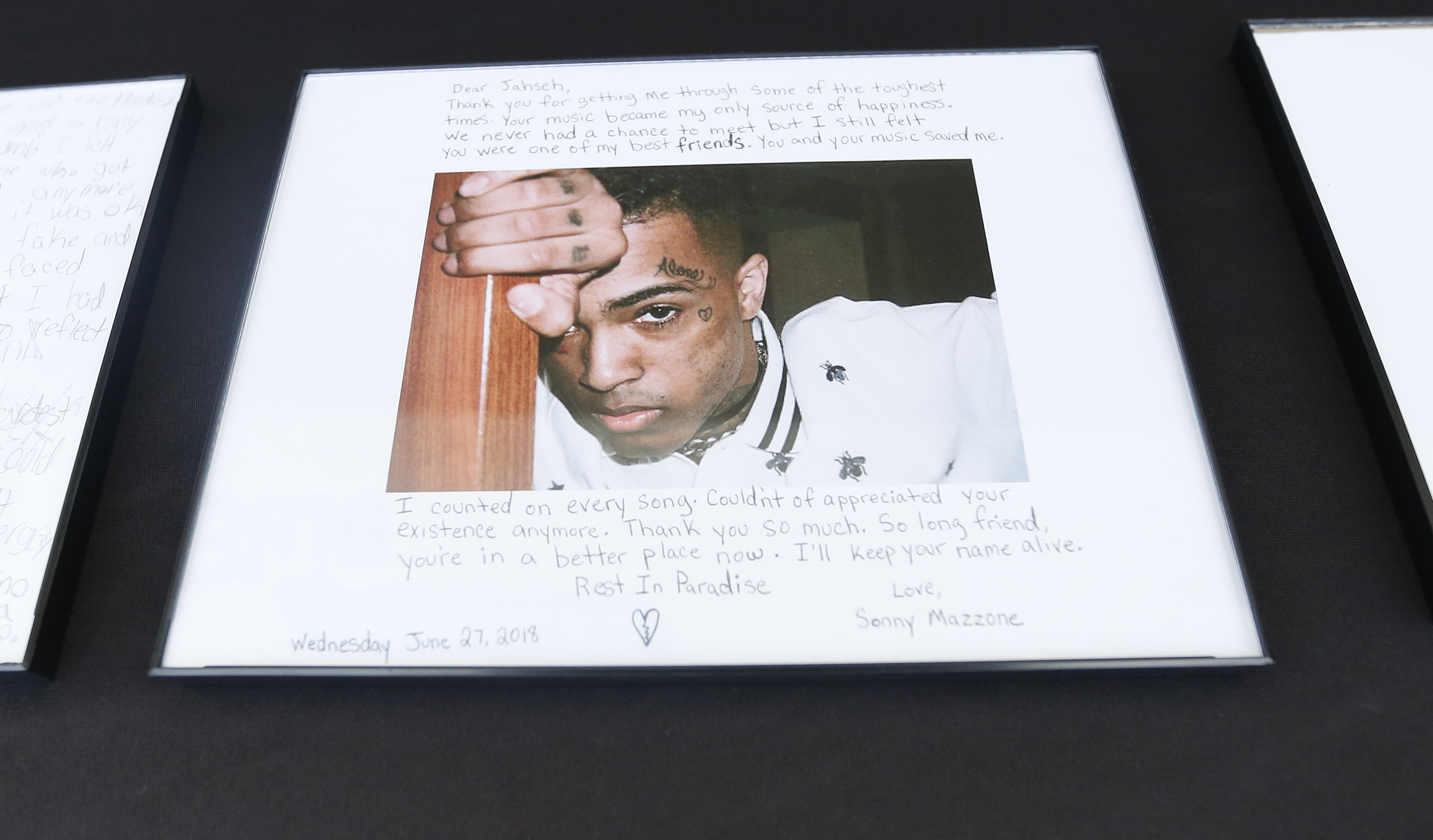 <div class='meta'><div class='origin-logo' data-origin='AP'></div><span class='caption-text' data-credit='AP'>A fan leaves a letter for slain rapper, XXXTentacion, during a memorial on Wednesday, June 27, 2018, in Sunrise, Fla. (AP Photo/Brynn Anderson)</span></div>