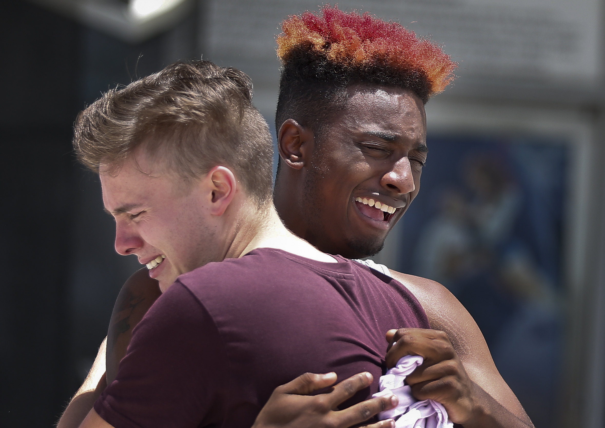 <div class='meta'><div class='origin-logo' data-origin='AP'></div><span class='caption-text' data-credit='AP'>D Bouey, 21, of Orlando, Fla., right, cries with his friend after a memorial for the rapper, XXXTentacion, Wednesday, June 27, 2018, in Sunrise, Fla. (AP Photo/Brynn Anderson)</span></div>