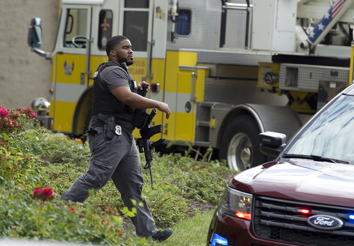 <div class='meta'><div class='origin-logo' data-origin='AP'></div><span class='caption-text' data-credit='AP Photo/Jose Luis Magana'>Maryland police officers patrol the area after multiple people were shot at a newspaper in Annapolis, Md., Thursday, June 28, 2018.</span></div>
