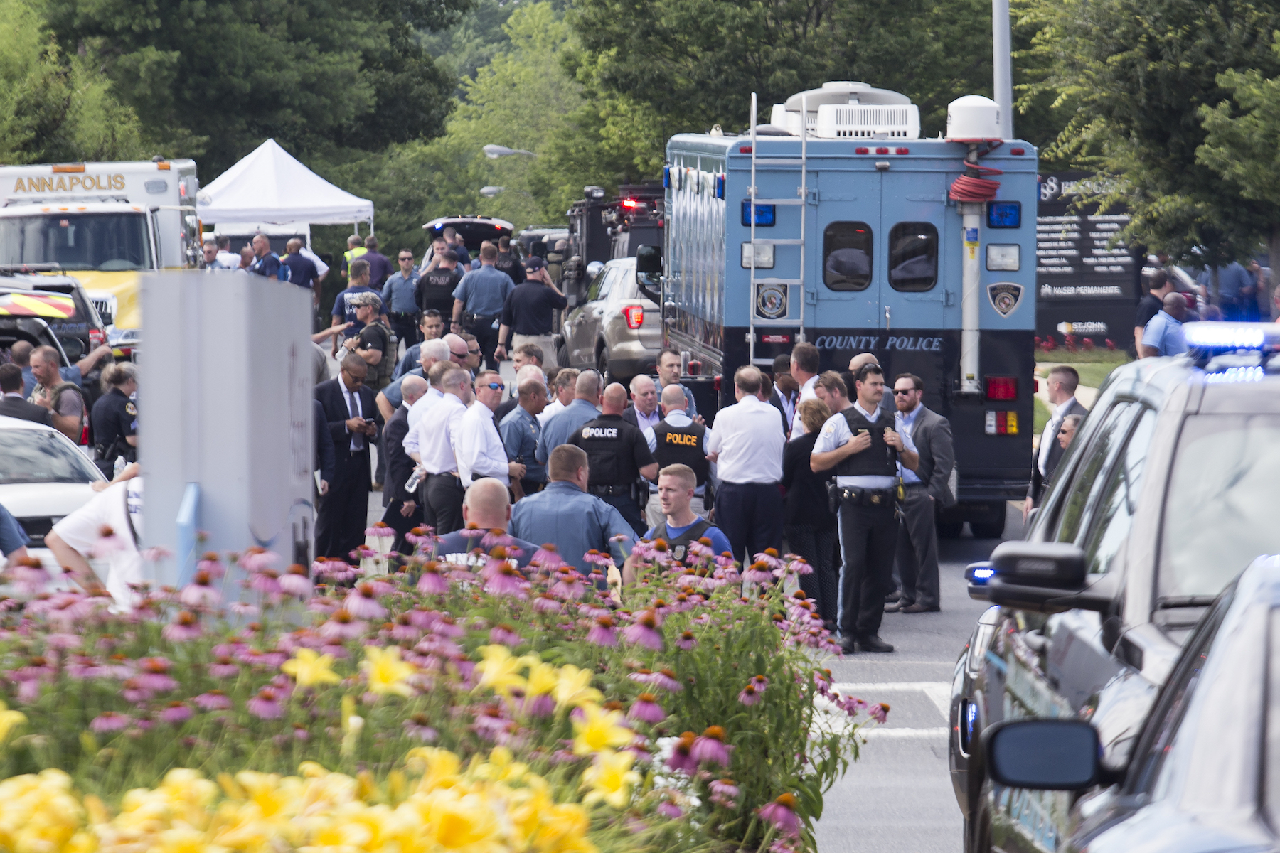 <div class='meta'><div class='origin-logo' data-origin='Creative Content'></div><span class='caption-text' data-credit='Saul Loeb/AFP/Getty Images'>Emergency personnel congregate outside the Capital-Gazette newspaper building on June 28, 2018 in Annapolis, Maryland.</span></div>
