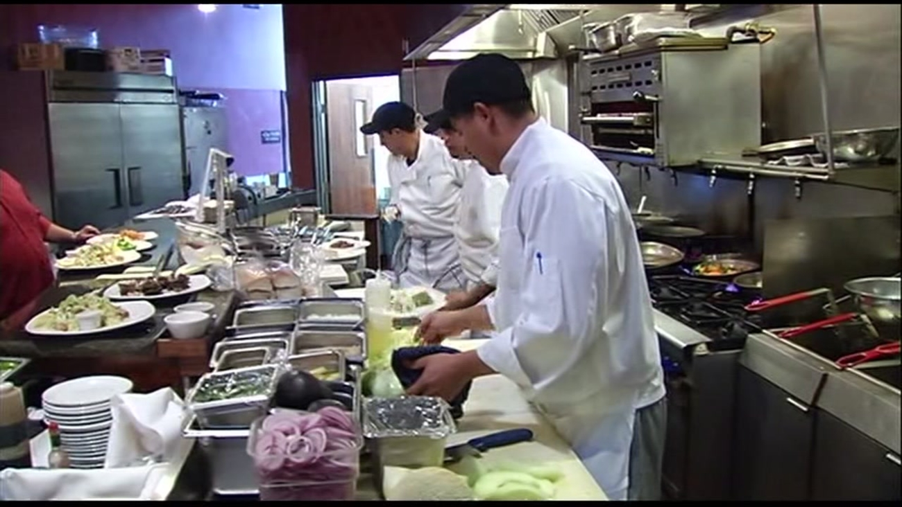 Employees work in a kitchen in this undated file photo.