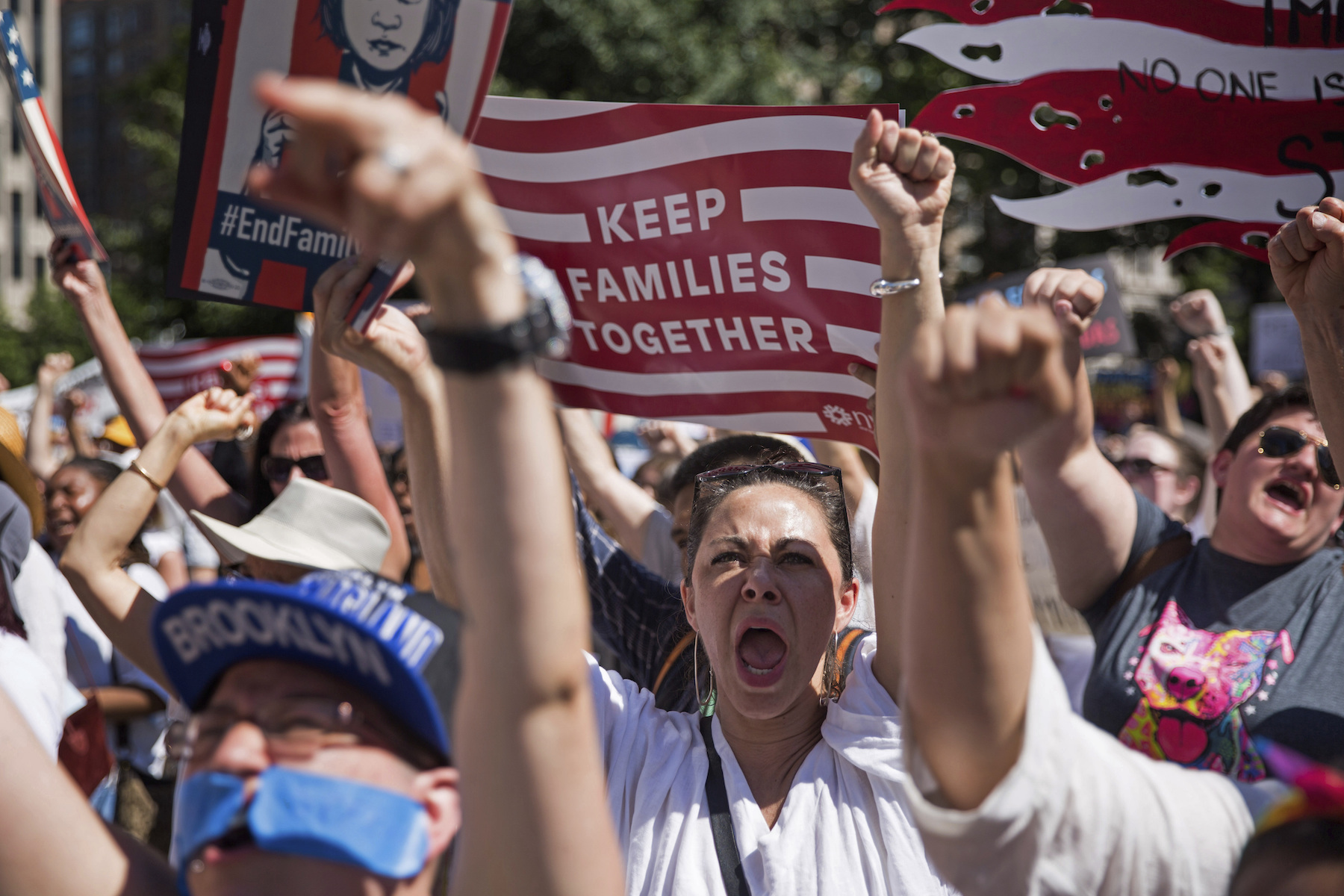 <div class='meta'><div class='origin-logo' data-origin='AP'></div><span class='caption-text' data-credit='AP Photo/Kevin Hagen'>Activists shout during the rally to protest the Trump administration's immigration policies Saturday, June 30, 2018, in New York, New York.</span></div>