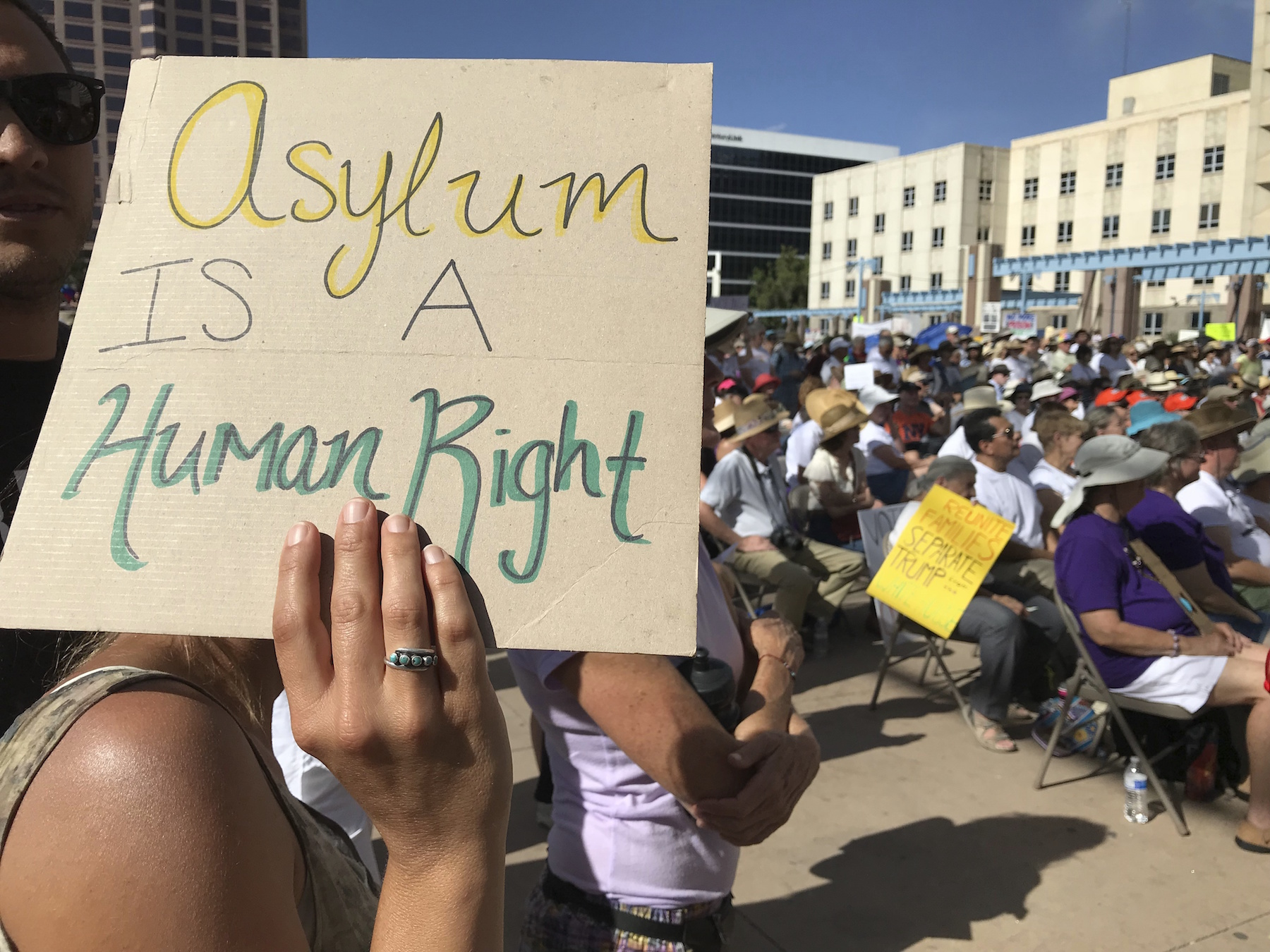 "<div class=""meta image-caption""><div class=""origin-logo origin-image ap""><span>AP</span></div><span class=""caption-text"">A protester holds up a sign as thousands gather for a demonstration on Civic Plaza in Albuquerque, N.M., on Saturday, June 30, 2018. (AP Photo/Susan Montoya Bryan)</span></div>"