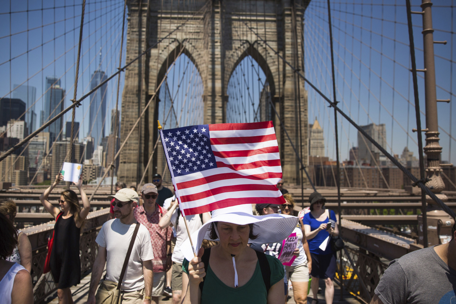 "<div class=""meta image-caption""><div class=""origin-logo origin-image ap""><span>AP</span></div><span class=""caption-text"">Activists carry signs across the Brooklyn Bridge during a rally to protest the Trump administration's immigration policies Saturday, June 30, 2018, in New York, New York. (AP Photo/Kevin Hagen)</span></div>"