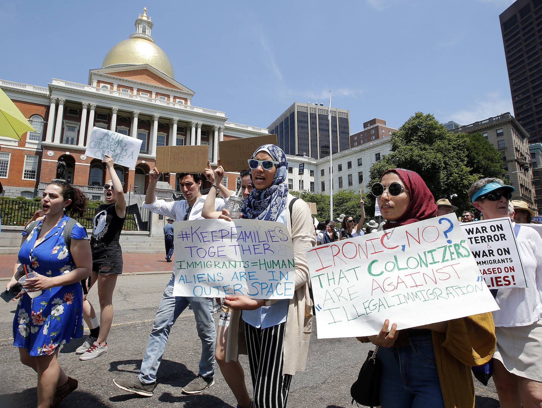 "<div class=""meta image-caption""><div class=""origin-logo origin-image ap""><span>AP</span></div><span class=""caption-text"">Lena Ismail, second from right, and Lamiya Khandaker, center, walk past the Massachusetts State House during a Rally Against Separation Saturday, June 30, 2018, in Boston. (AP Photo/Winslow Townson)</span></div>"