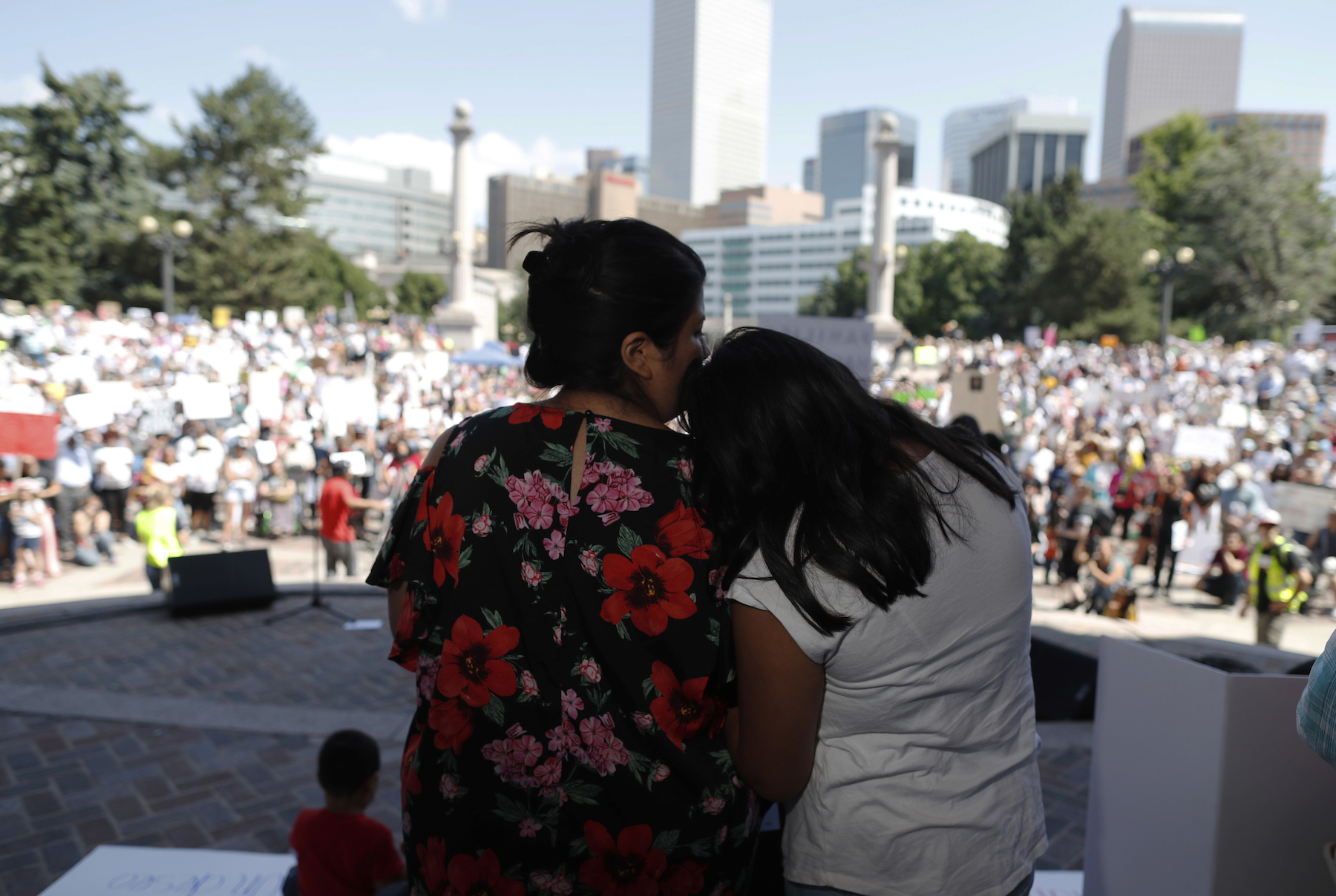 <div class='meta'><div class='origin-logo' data-origin='AP'></div><span class='caption-text' data-credit='AP Photo/David Zalubowski'>Brenda Villa, left, comforts her 11-year-old daughter, Kathryn, after speaking during an immigration rally and protest in Civic Center Park Saturday, June 30, 2018, in Denver.</span></div>