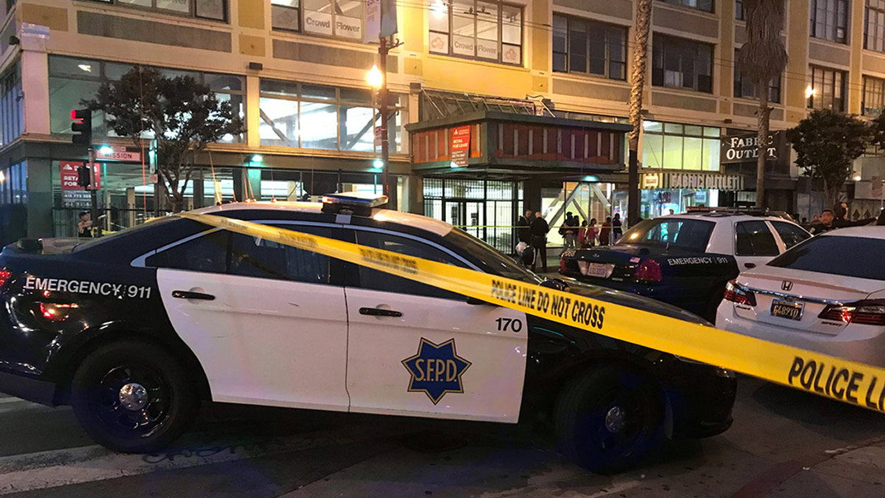 Police cars block the road after a shooting in San Francisco's Mission District on June 30, 2018.