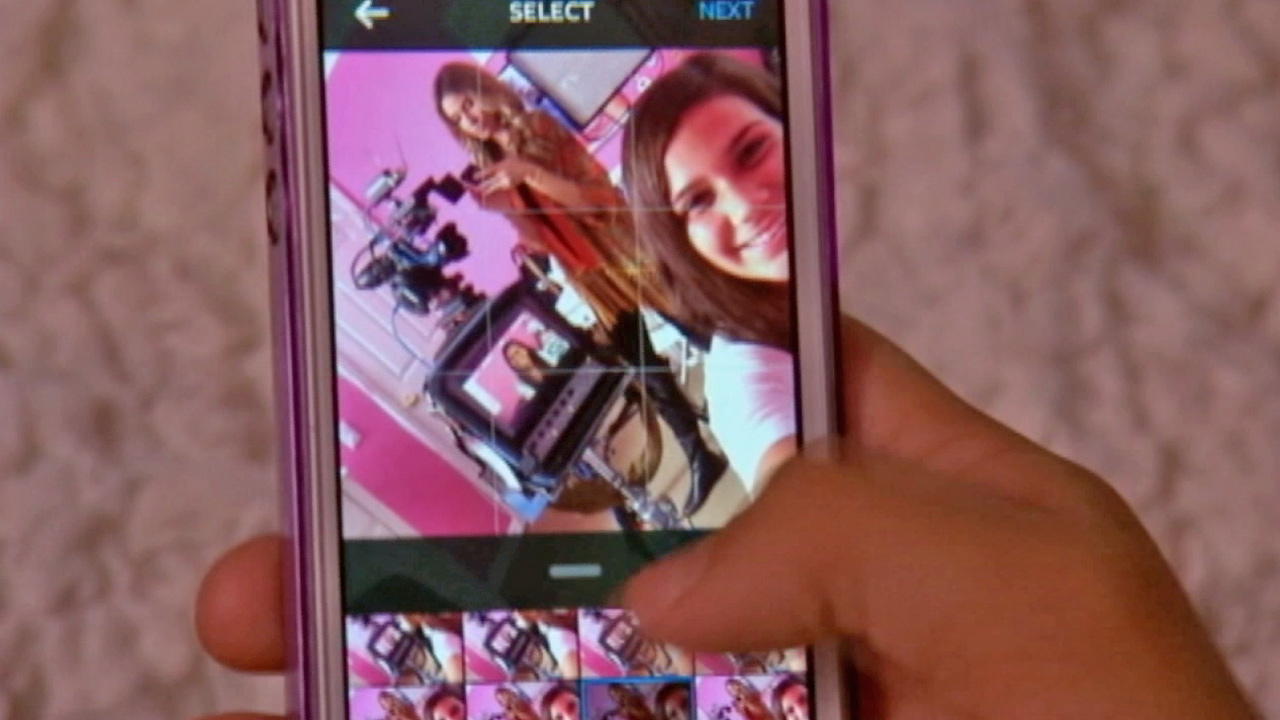 A girl posts a selfie to Instagram in this undated photo.