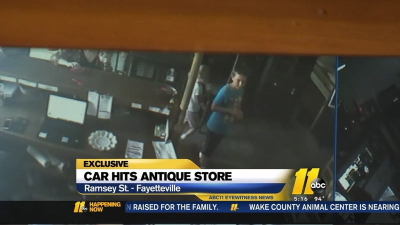 SUV crashes into Fayetteville antique store, narrowly missing children