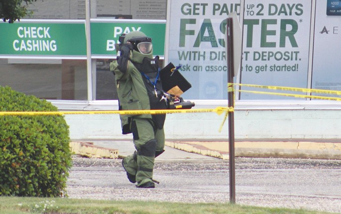 <div class='meta'><div class='origin-logo' data-origin='WTVD'></div><span class='caption-text' data-credit='SBI'>An SBI Bomb Technician after clearing a suspicious package used in an attempted robbery in Wilson, NC.</span></div>