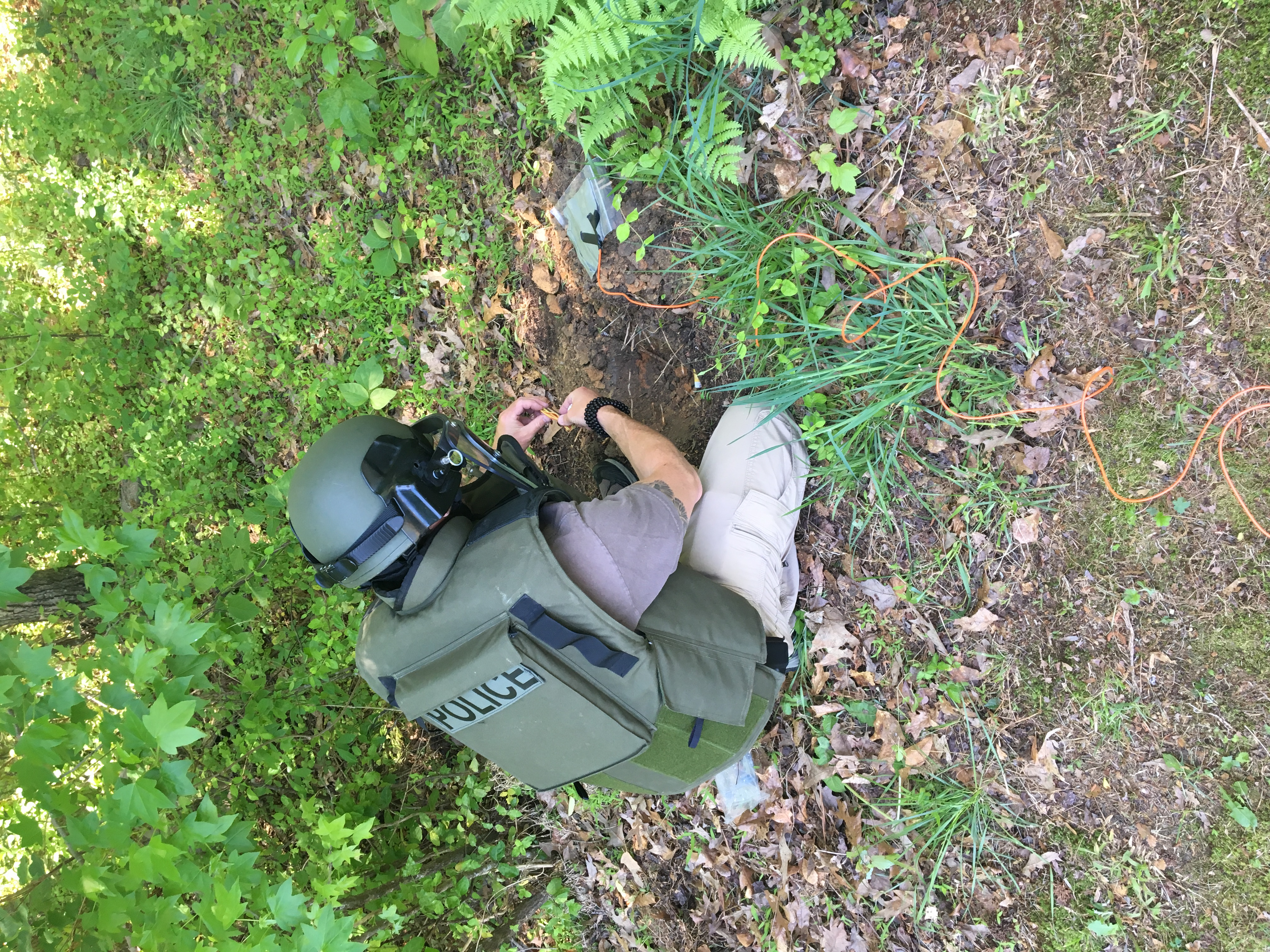 <div class='meta'><div class='origin-logo' data-origin='WTVD'></div><span class='caption-text' data-credit='SBI'>A Bomb Technician prepares to dispose of some blasting caps located in a house in Lee County earlier in 2018. This was a non-criminal case.</span></div>