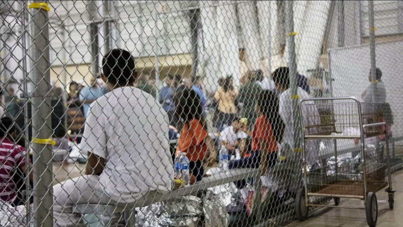 Immigrants appear in a border facility in this undated image.