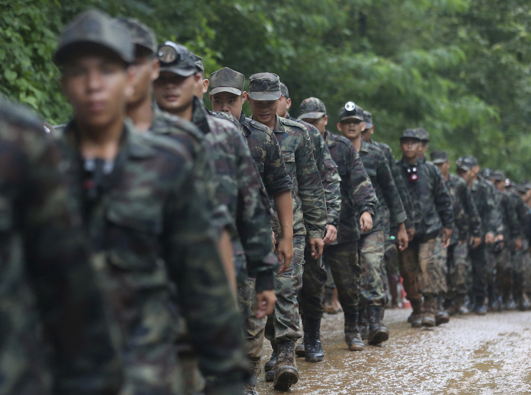 "<div class=""meta image-caption""><div class=""origin-logo origin-image ap""><span>AP</span></div><span class=""caption-text"">Thai soldiers line up to the cave area as they continue the search for a young soccer team and their coach believed to be missing in a large cave, Wednesday, June 27, 2018. (AP Photo/Sakchai Lalit)</span></div>"