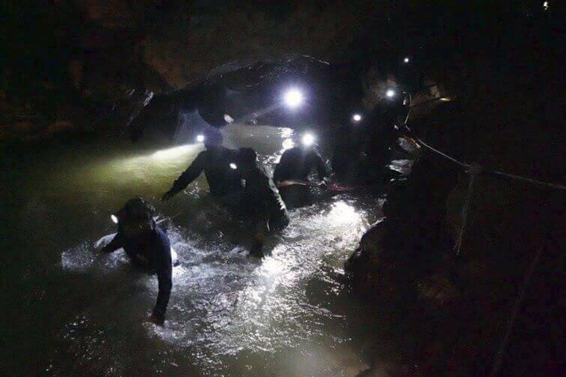 "<div class=""meta image-caption""><div class=""origin-logo origin-image ap""><span>AP</span></div><span class=""caption-text"">Thai rescues team walk inside cave complex where 12 boys and their soccer coach went missing, in Mae Sai, Chiang Rai province, in northern Thailand, Monday, July 2, 2018. (Tham Luang Rescue Operation Center via AP)</span></div>"