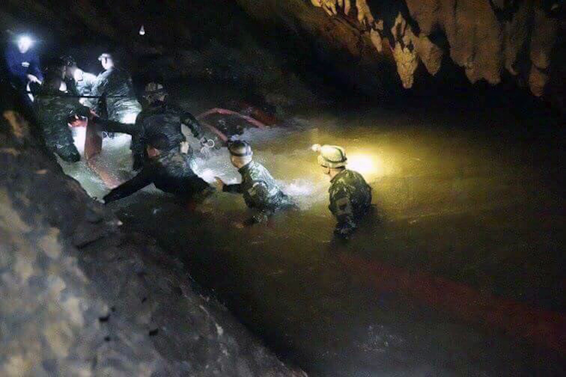 <div class='meta'><div class='origin-logo' data-origin='AP'></div><span class='caption-text' data-credit='Tham Luang Rescue Operation Center via AP'>Thai rescues team walk inside cave complex where 12 boys and their soccer coach went missing, in Mae Sai, Chiang Rai province, in northern Thailand, Monday, July 2, 2018.</span></div>